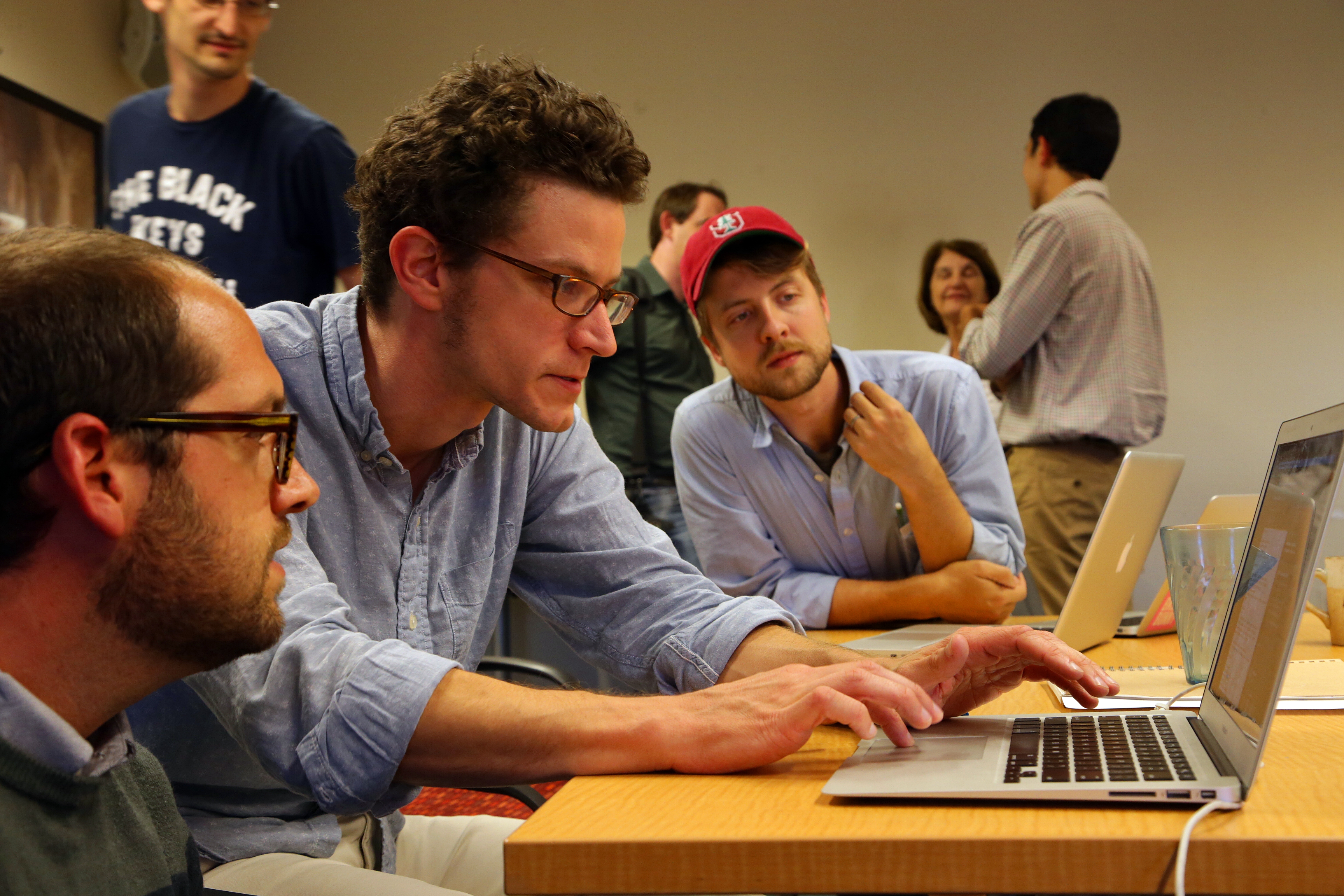 Jeremy Dean, center, shows students how they might use Rapgenius as part of their teaching scheme during a workshop on teaching humanities in the digital age at Stanford University in Palo Alto, Calif.