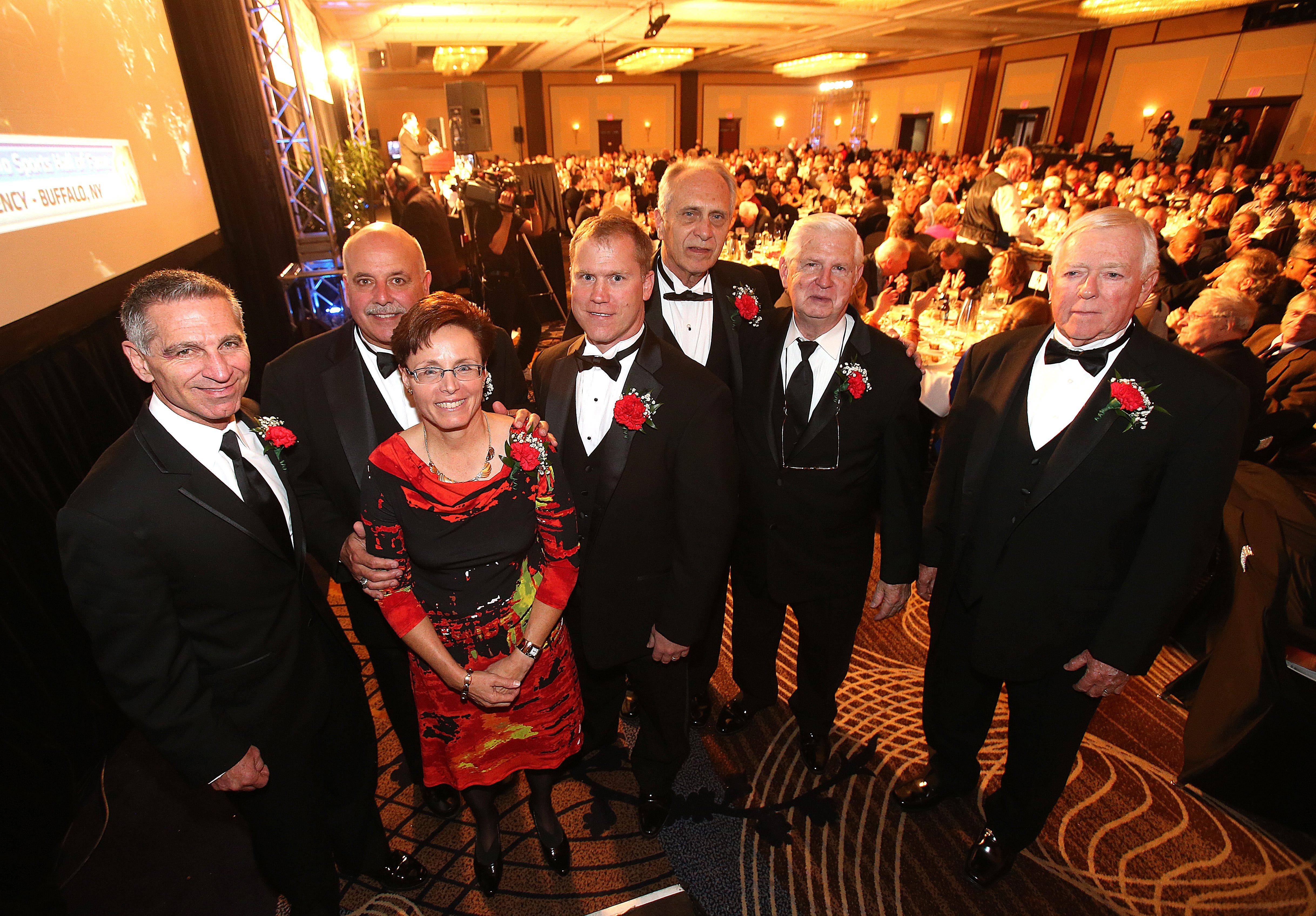 From left, Phil McConkey, Dick Diminuco, Pam Amabile, Todd Marchant, Milt Northrop, Art Jeziorski and Fred Hartrick at the Greater Buffalo Sports Hall of Fame induction dinner at the Hyatt Regency.