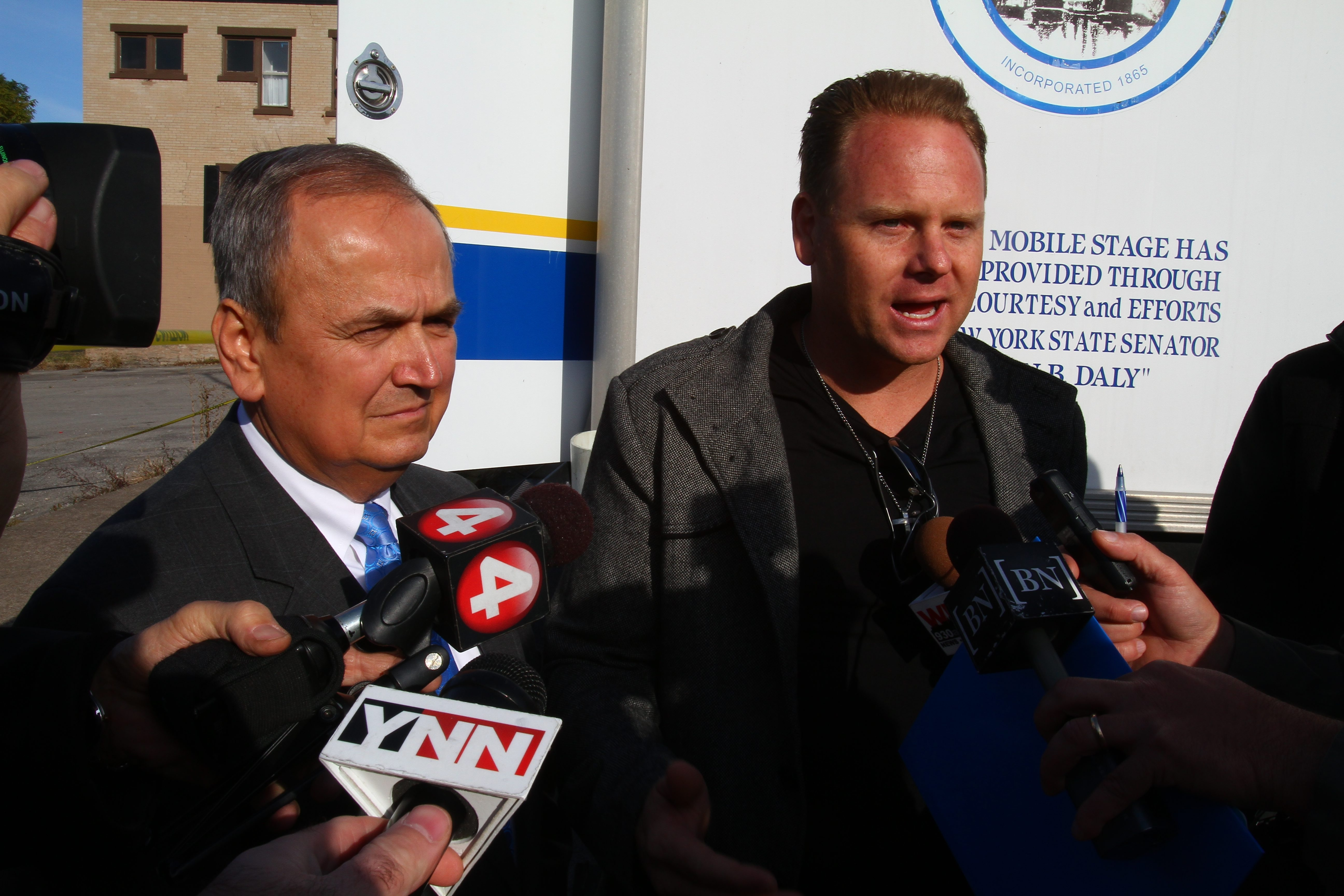 State Sen. George Maziarz, left,  and Nik Wallenda attend a groundbreaking Tuesday for Lockport's new $12 million twin-rink ice arena.