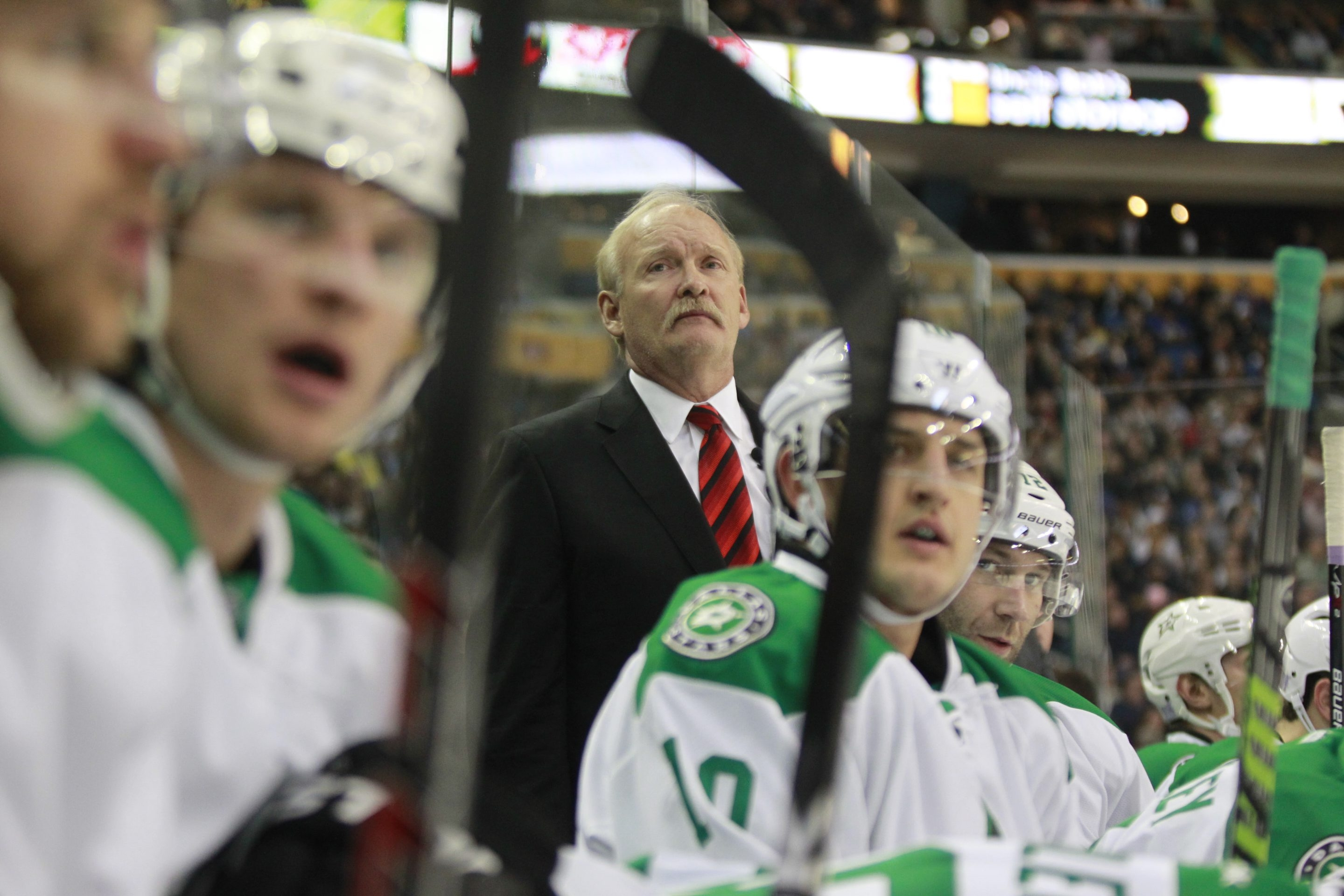 Lindy Ruff, now coach of the Dallas Stars after 26 years as a player and coach for the Sabres, directs his new team during Monday night's game in First Niagara Center that Dallas won, 4-3. Ruff received a video tribute and a standing ovation during the game.