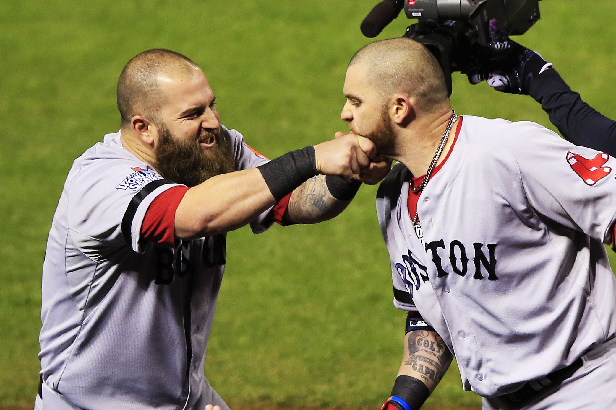 Mike Napoli, left, pulls on the beard of Red Sox teammate Jonny Gomes after Gomes belted a three-run home run to left against Seth Maness of the Cardinals in the sixth inning during Game Four. Gomes was a last-minute starter in left field when Shane Victorino was scratched.