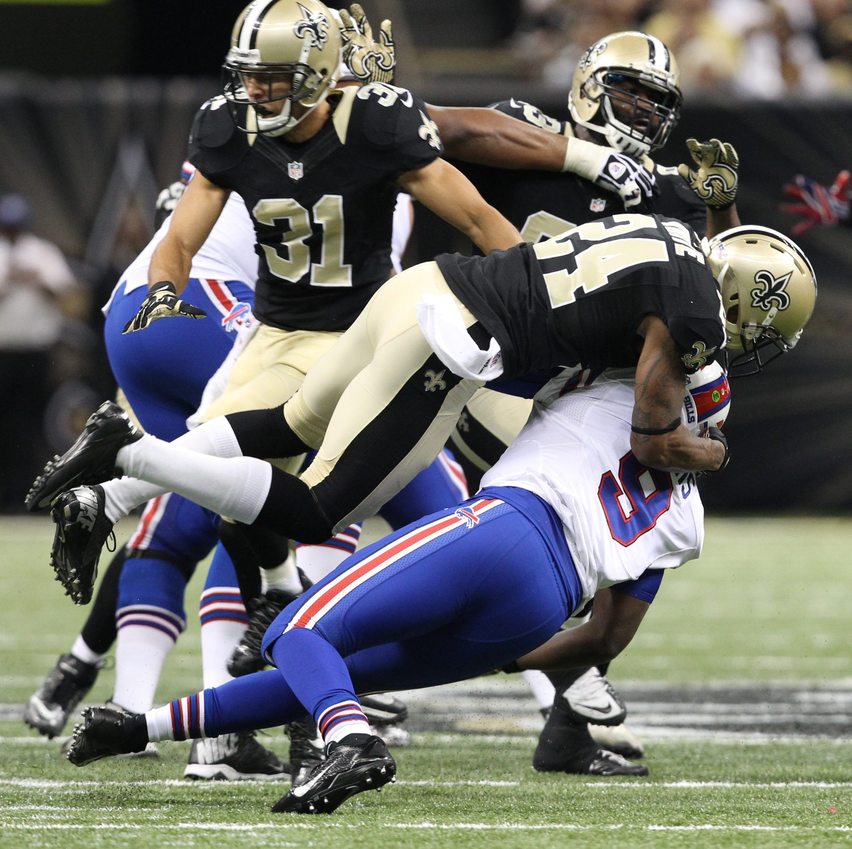 Bills quarterback Thad Lewis is hammered and forced to throw an incomplete pass by Saints cornerback Corey White in the third quarter Sunday.