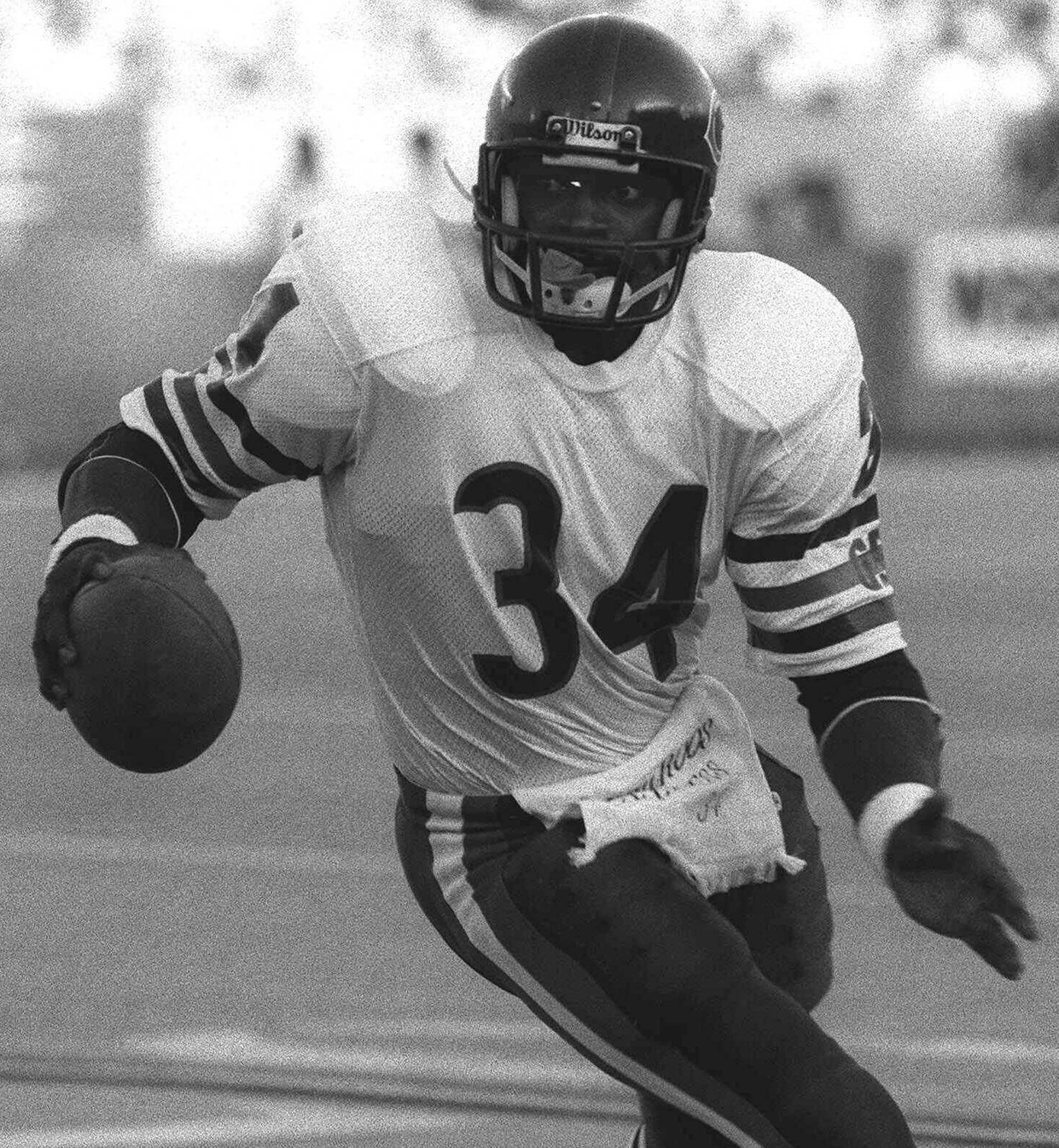 Chicago Bears running back Walter Payton carries the ball at Soldier Field in Chicago in this 1985 photo.
