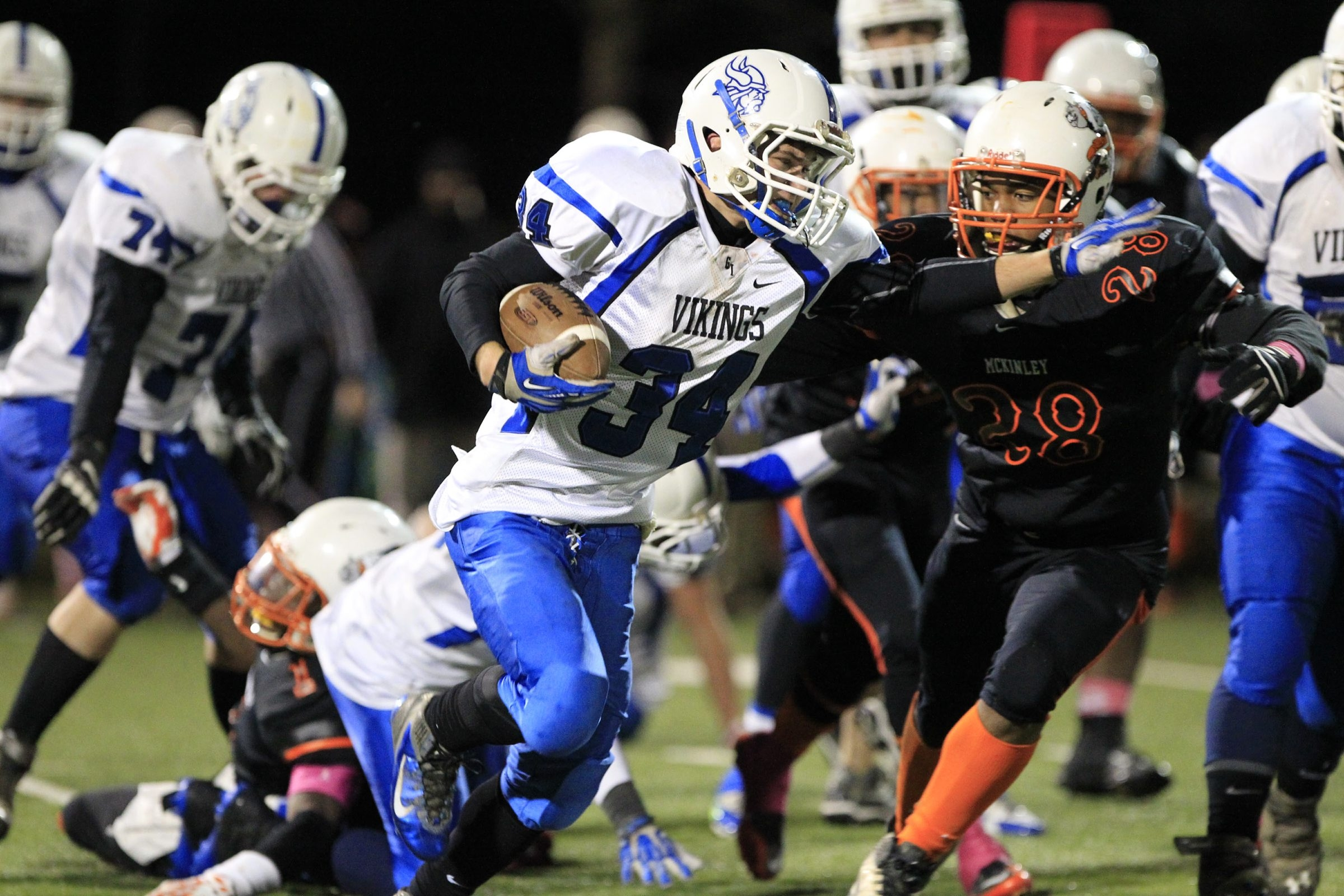 Grand Island running back Jarod Brandon looks for running room against McKinley's Quajon Taylor during a Class A Section VI playoff at Riverside high school. More coverage on Pages B6-7.
