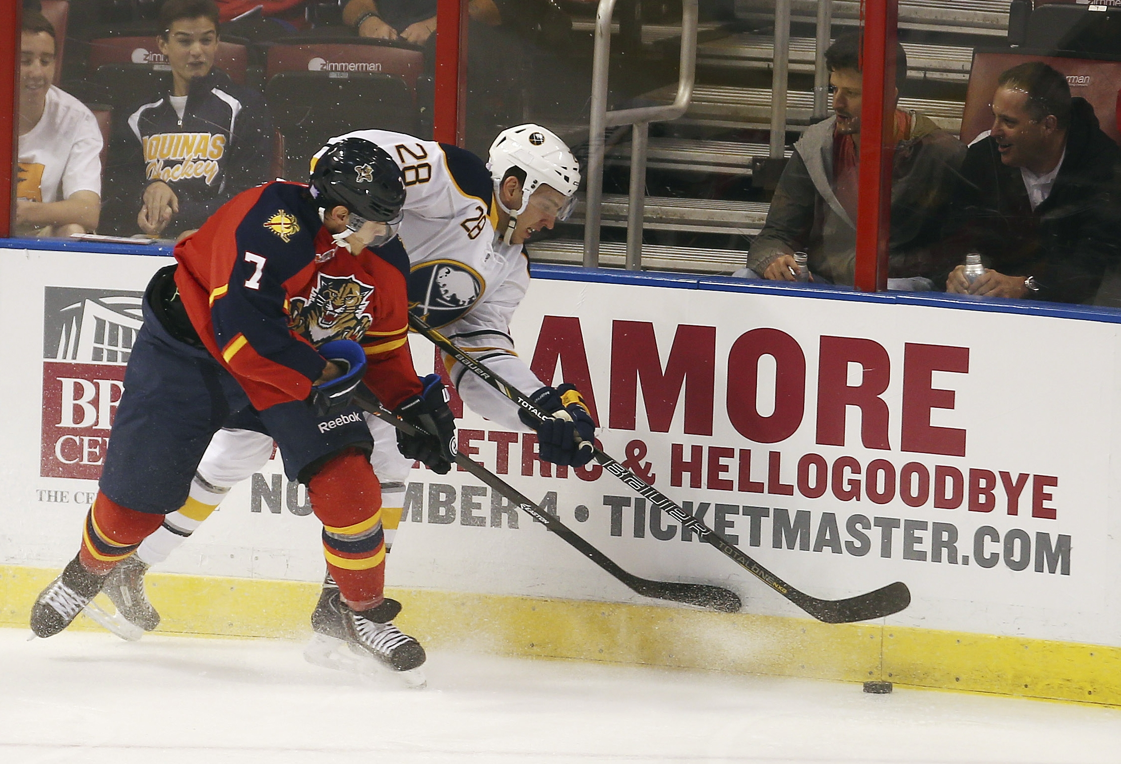 Florida's Dmitry Kulikov and Buffalo's Zemgus Girgensons battle for the puck during the first period.