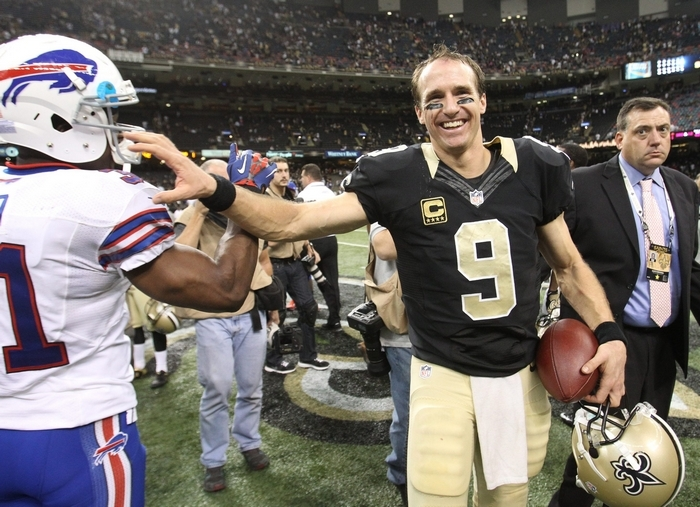 Saints quarterback Drew Brees shares a joke with Bills free safety Jairus Byrd after a five-touchdown game. (James P. McCoy/Buffalo News)