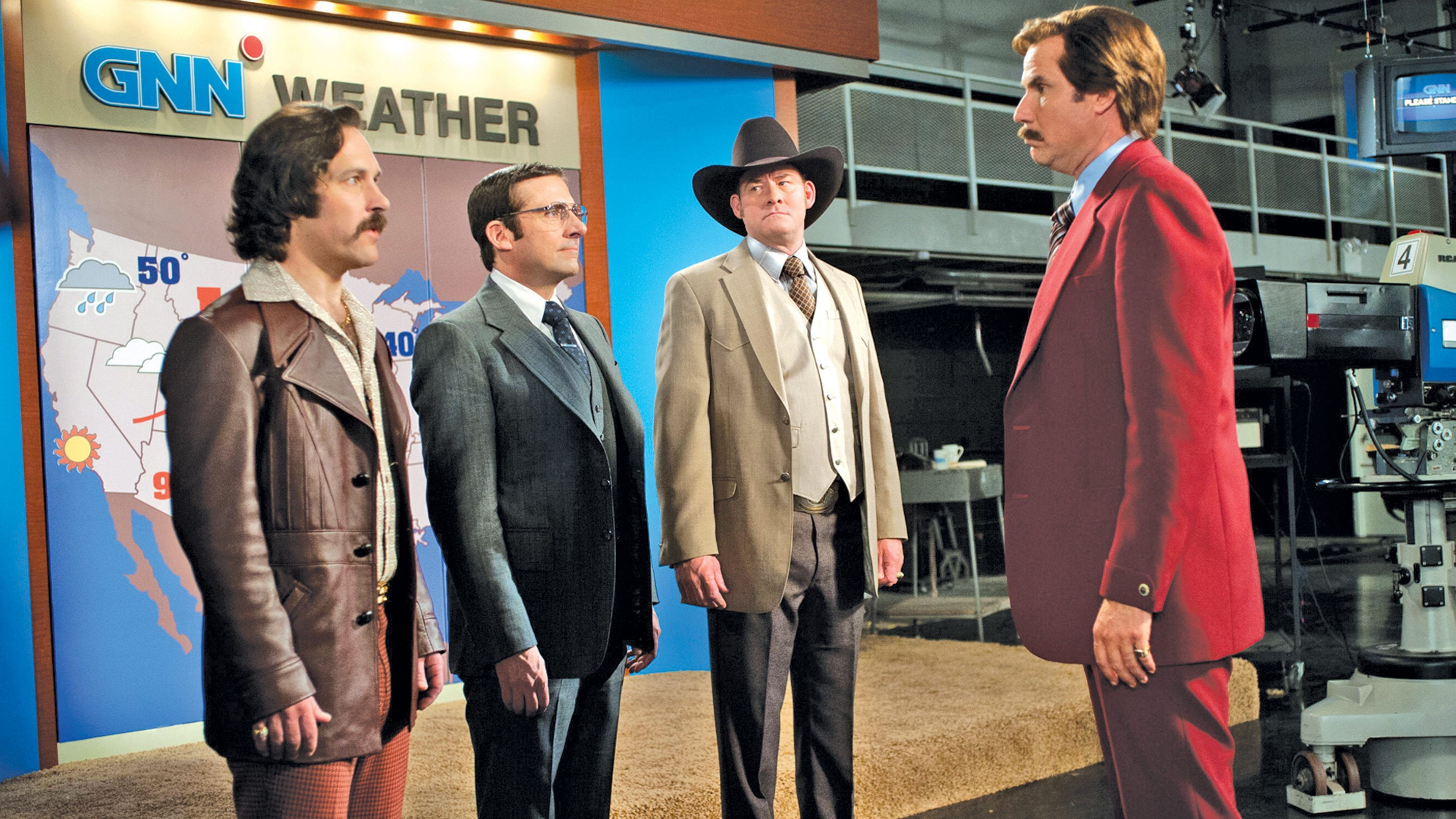 "From left, Paul Rudd, Steve Carell, David Koechner and Will Ferrell in a scene from ""Anchorman 2,"" which opens Dec. 18."
