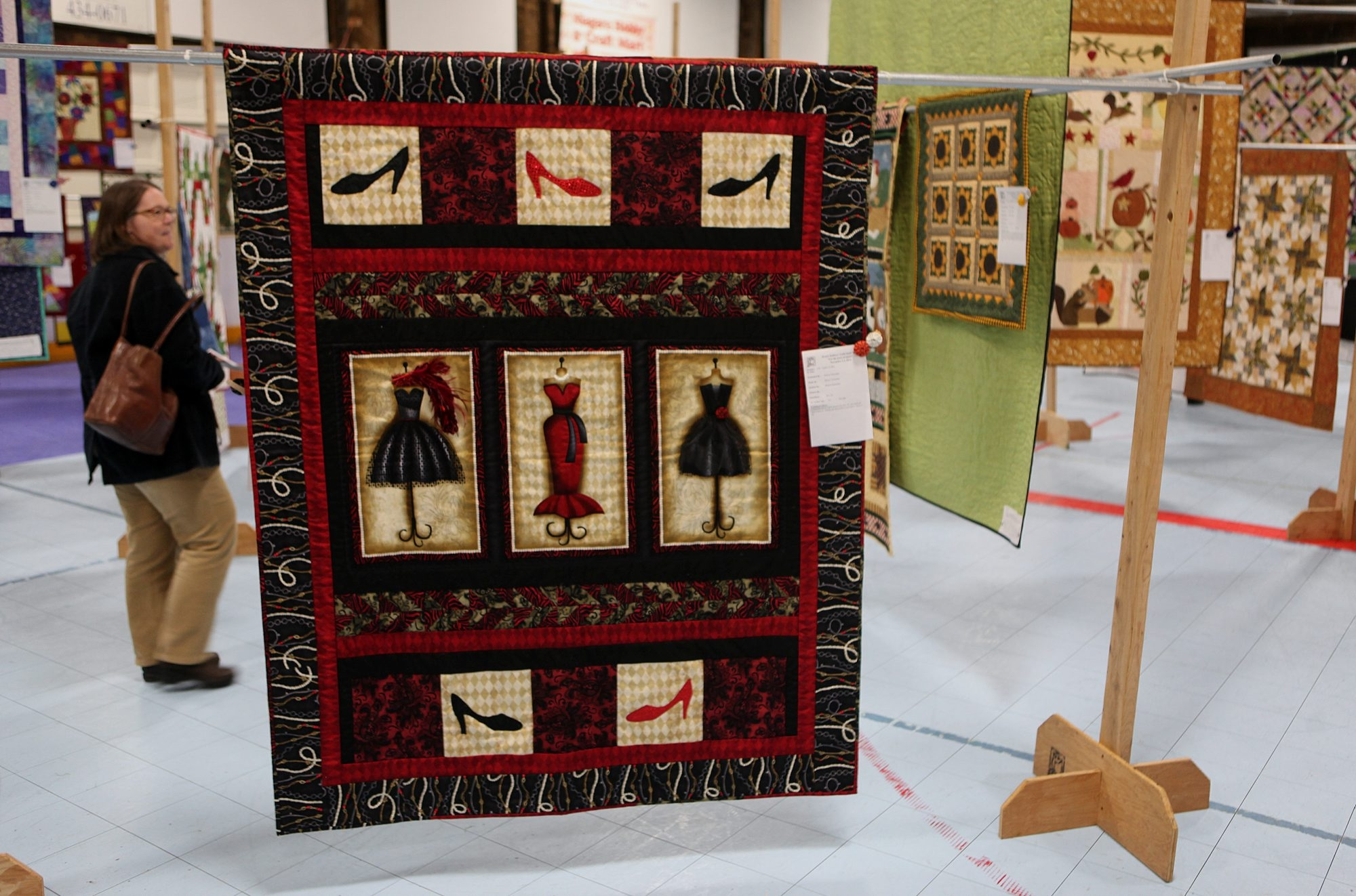 Attendees look at some large quilts on display Friday during the quilt show at the Kenan Center in Lockport.