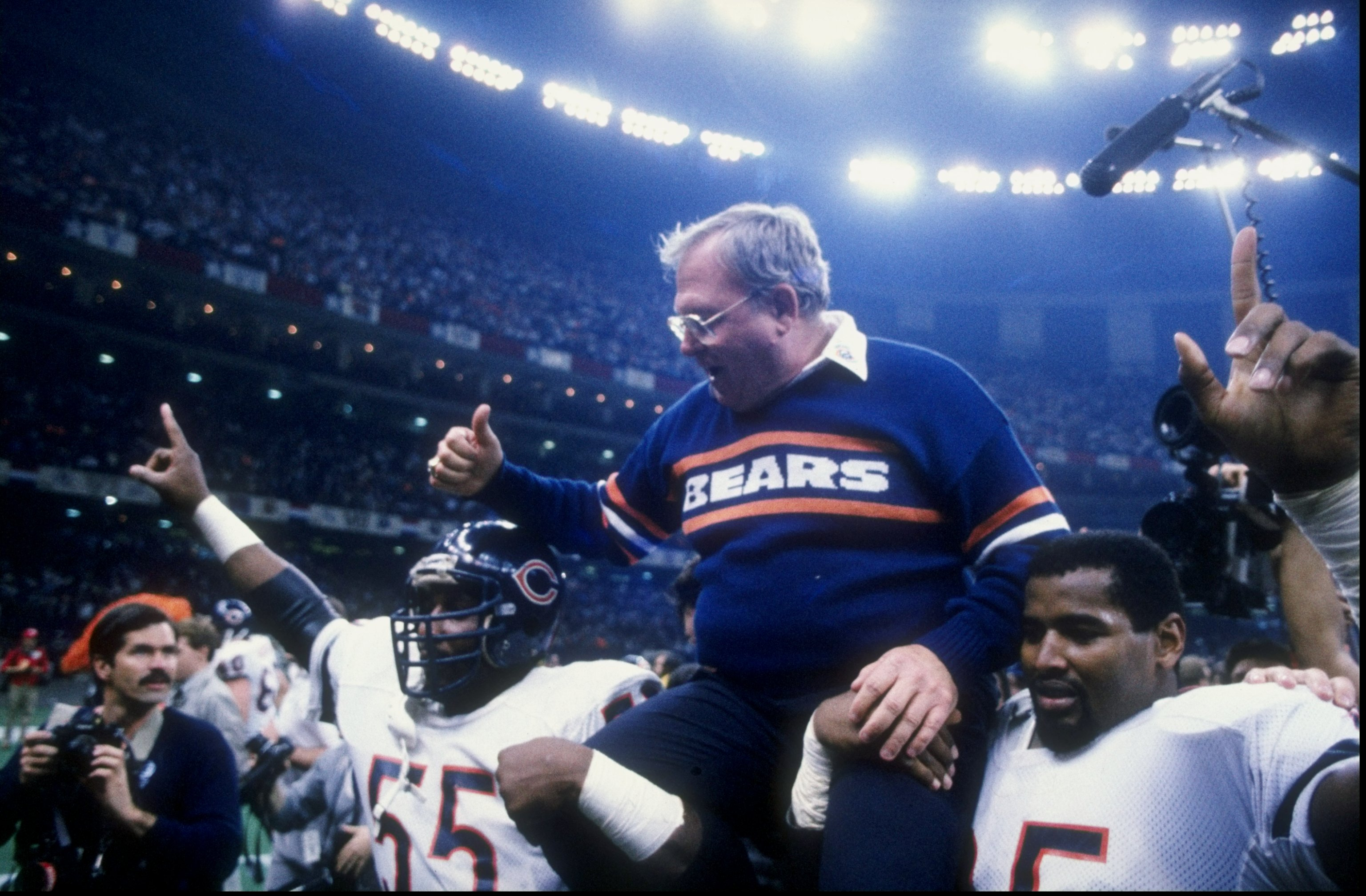 26 Jan 1986: Defensive coach Buddy Ryan and defensive end Richard Dent of the Chicago Bears celebrate after the Super Bowl XX game against the New England Patriots at the Louisiana Superdome in New Orleans, Louisiana. The Bears defeated the Patriots 46-10