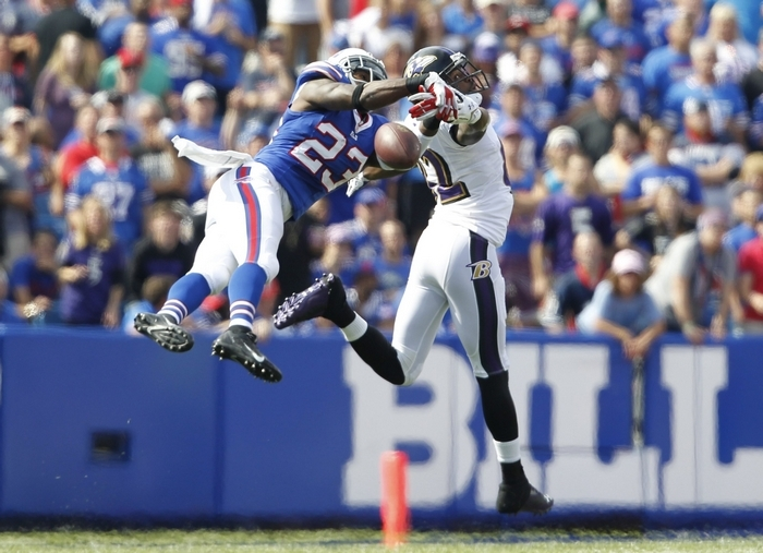 Aaron Williams breaks up a pass intended for the Ravens' Torrey Smith during Sunday's game at Ralph Wilson Stadium. (Harry Scull Jr./Buffalo News)