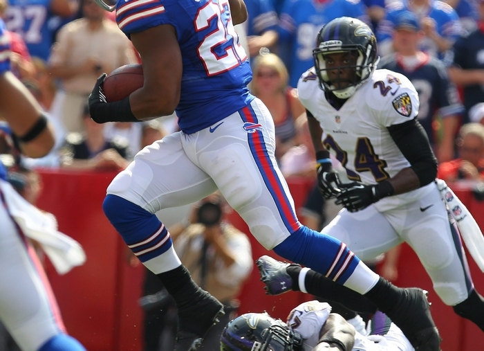 The Bills' Fred Jackson leaps over the Ravens' Matt Elam for a touchdown. Jackson's run was one of 55 rushing plays called by Nathaniel Hackett on Sunday, the Bills' most in a game since 1996.  (Mark Mulville/Buffalo News)