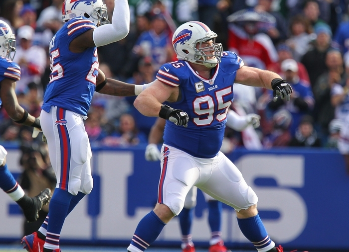 The Bills' Da'Norris Searcy, left, and Kyle Williams celebrate a first-quarter sack, which was the beginning of a long day for the Jets' offense at Ralph Wilson Stadium. (Mark Mulville/Buffalo News)
