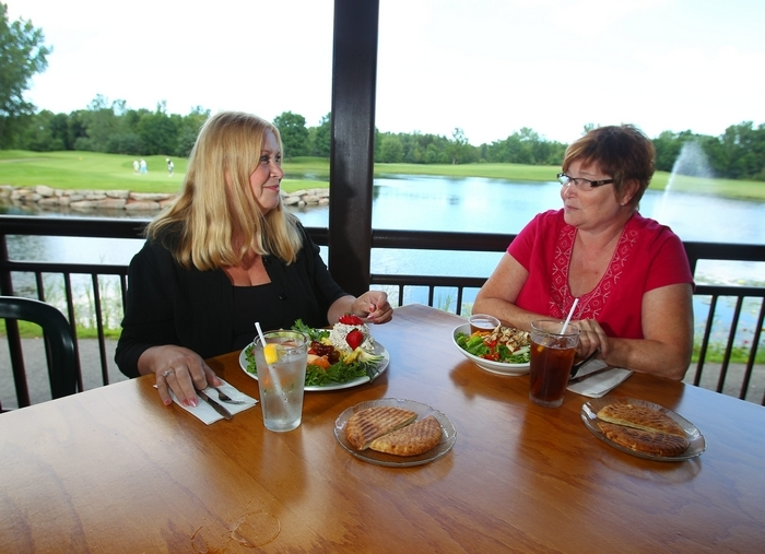 Bonnie Kubic, left, of Lockport, enjoys a pineapple chicken salad and Linda Dolpp of Tonawanda lunches on a Thai chicken salad at Willowbrook Restaurant in Lockport. (John Hickey/Buffalo News)