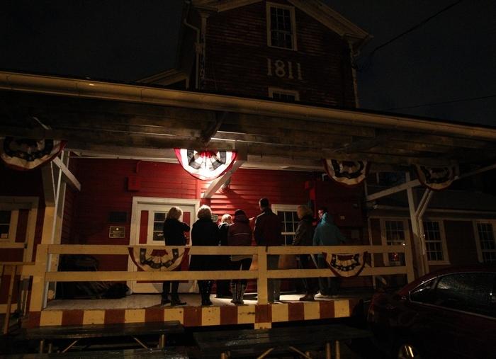 Cassandra Butler begins her Haunted History Ghost Walk of Williamsville at the Williamsville Water mill. (Sharon Cantillon/Buffalo News)