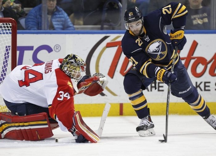 Buffalo Sabres player Drew Stafford (21) tries to beat Florida Panther goaltender, Tim Thomas (34) during third period action at the First Niagara Center,on,Tuesday, Jan. 21, 2014. .(Harry Scull Jr./Buffalo News)