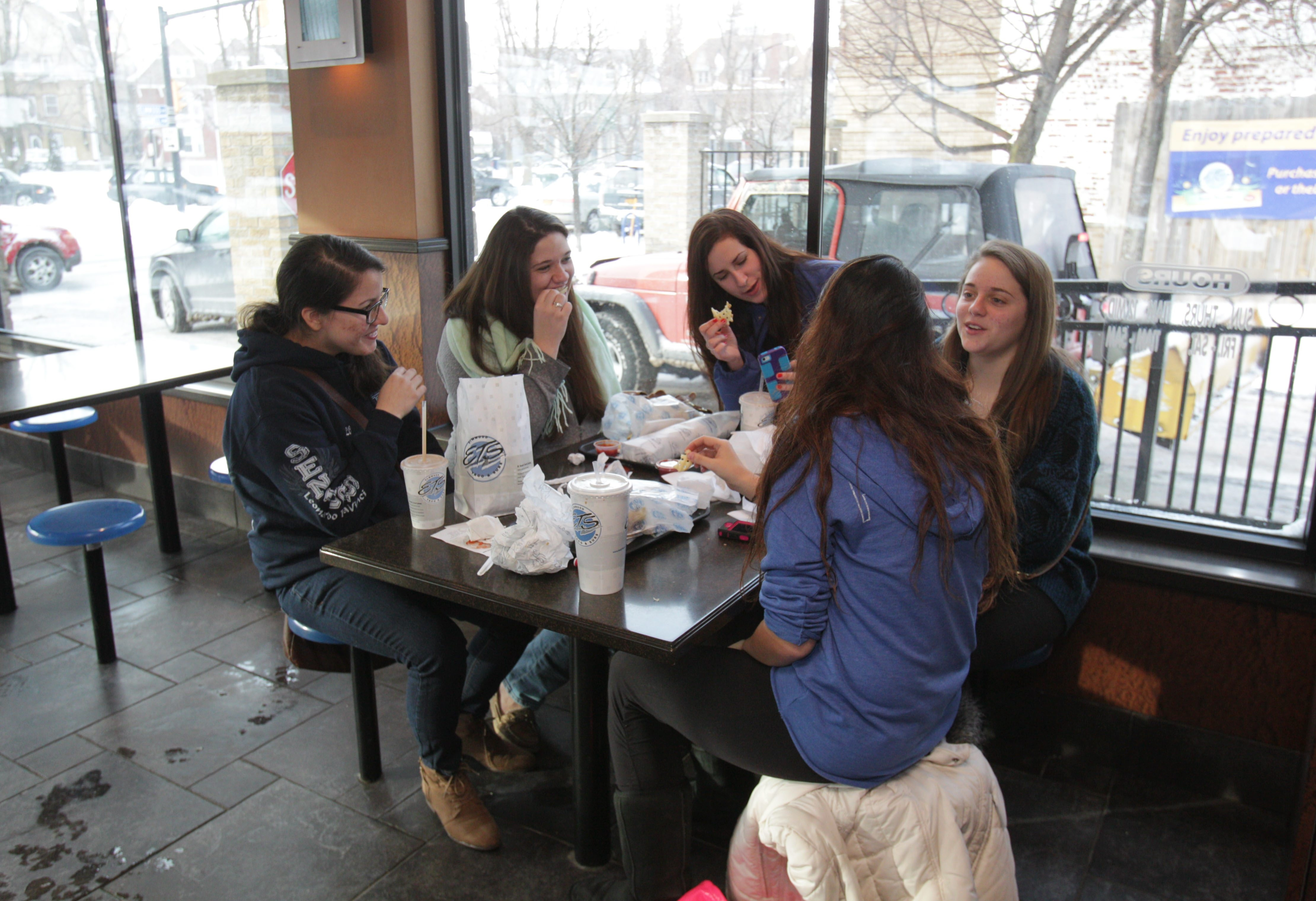 Area teens looking for something to do – or eat – often head to Hertel and Elmwood avenues. Here, friends from Leonardo DaVinci and City Honors high schools grabbed a bite to eat at Elmwood Taco & Subs. From left are Lindsay Olivieri, Tess Cullen, Leanna Gradolph, Leia LaBruna and Gabrielle Reh (back to camera).