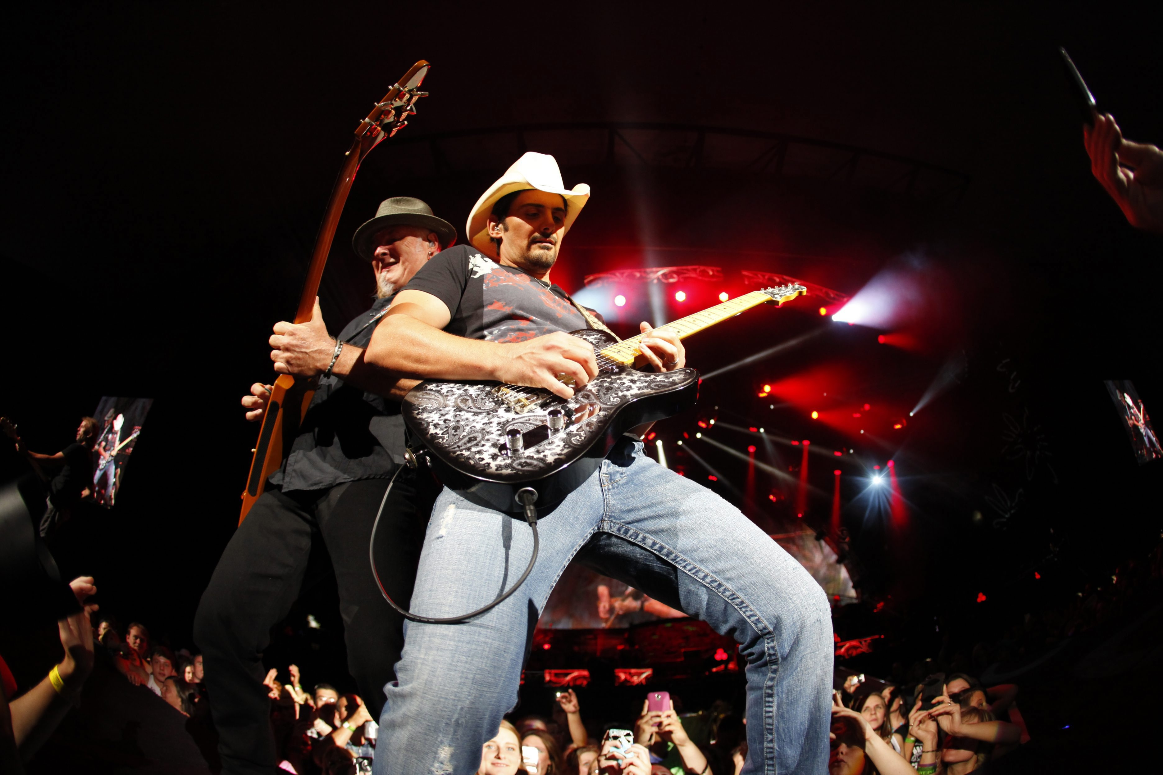 """Making a return trip this summer will be Brad Paisley, shown performing last summer during the """"Beat This Summer Tour"""" on July 12."""