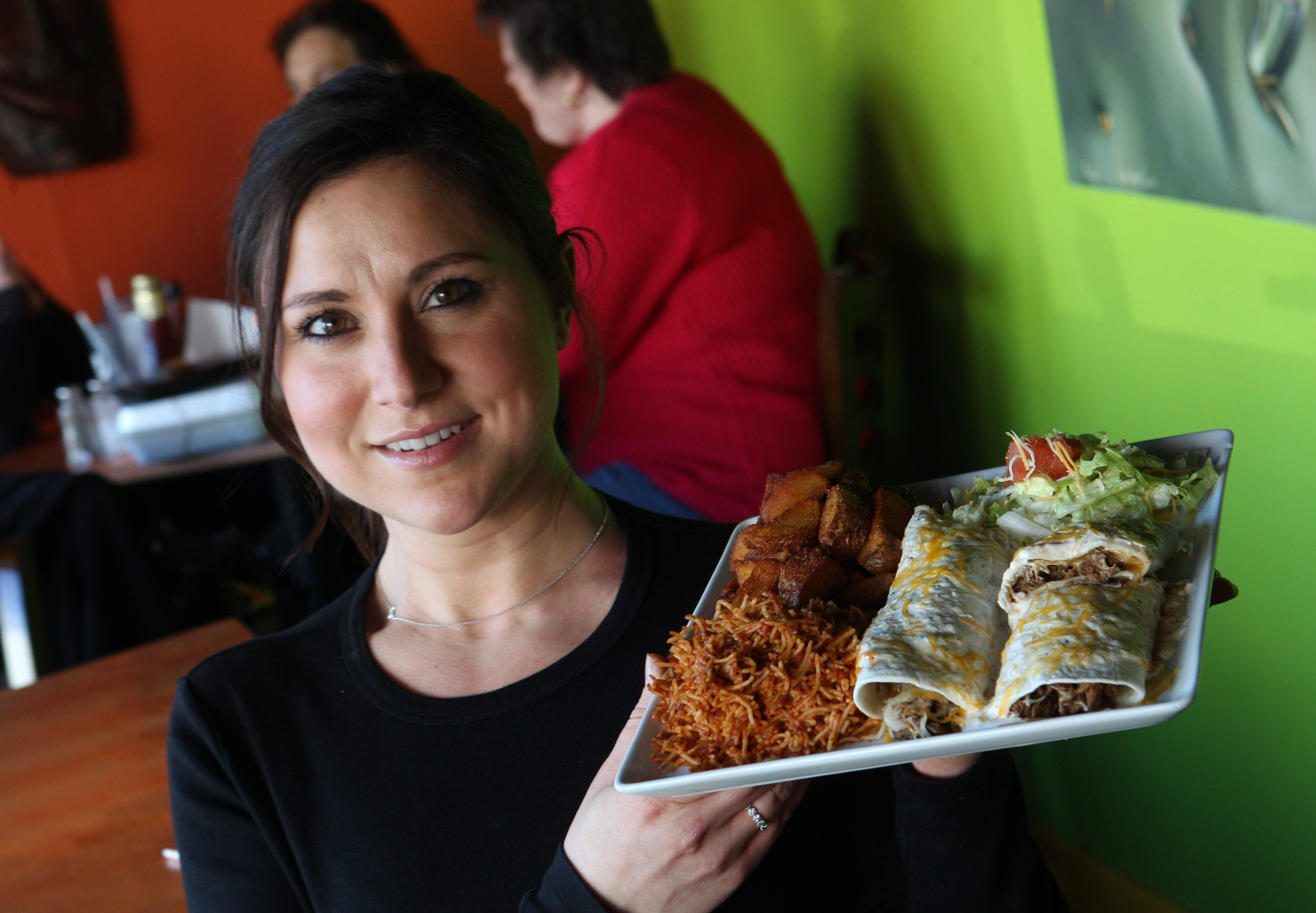 Morning Manager Kristy Gerber presents the beef matchatka plate at Coyote Cafe in Hamburg. Owner Jeff Giovino says he learned to cook from his Grandma Mora.
