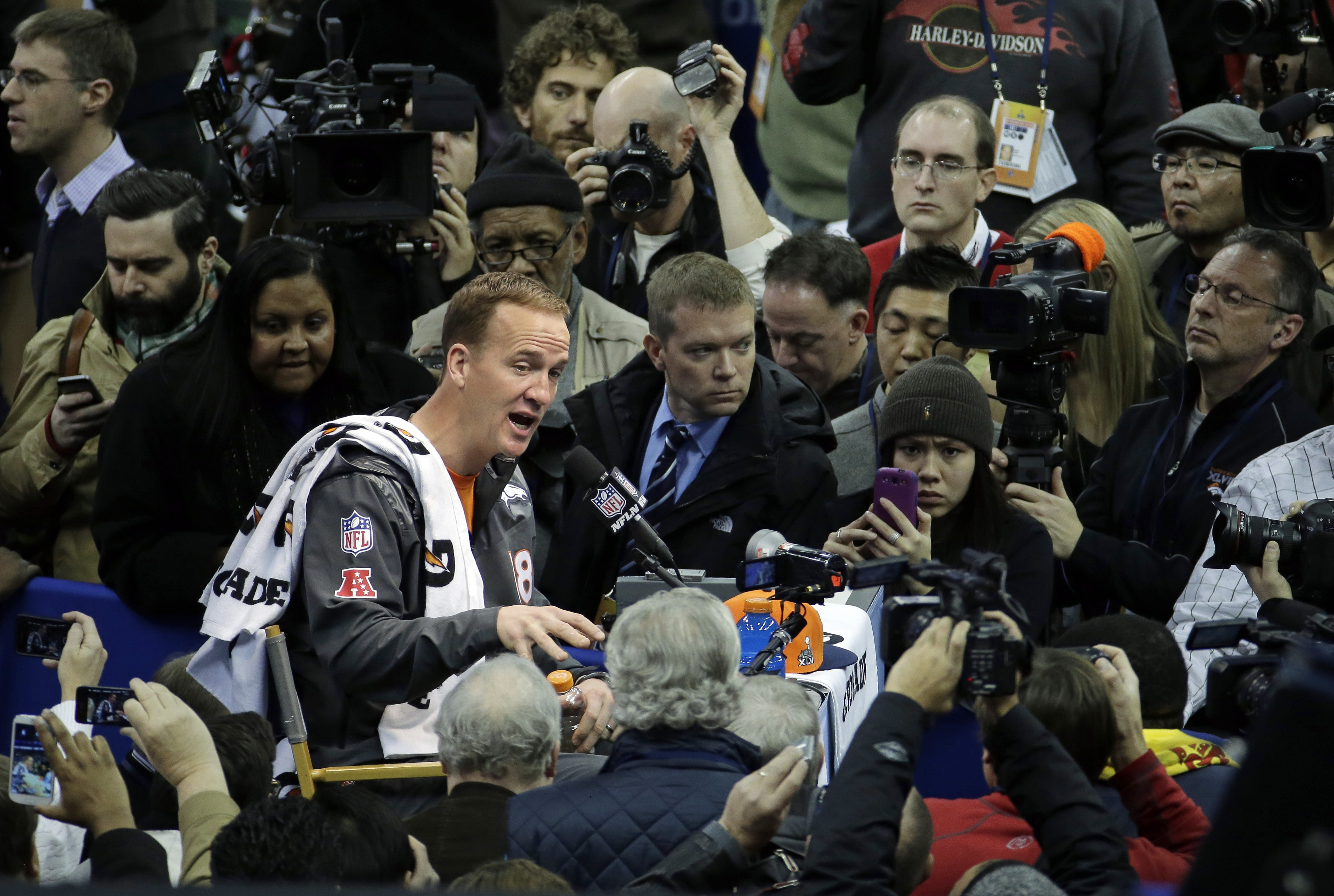 Peyton Manning answers questions from the horde of journalists at Super Bowl XLVIII Media Day.