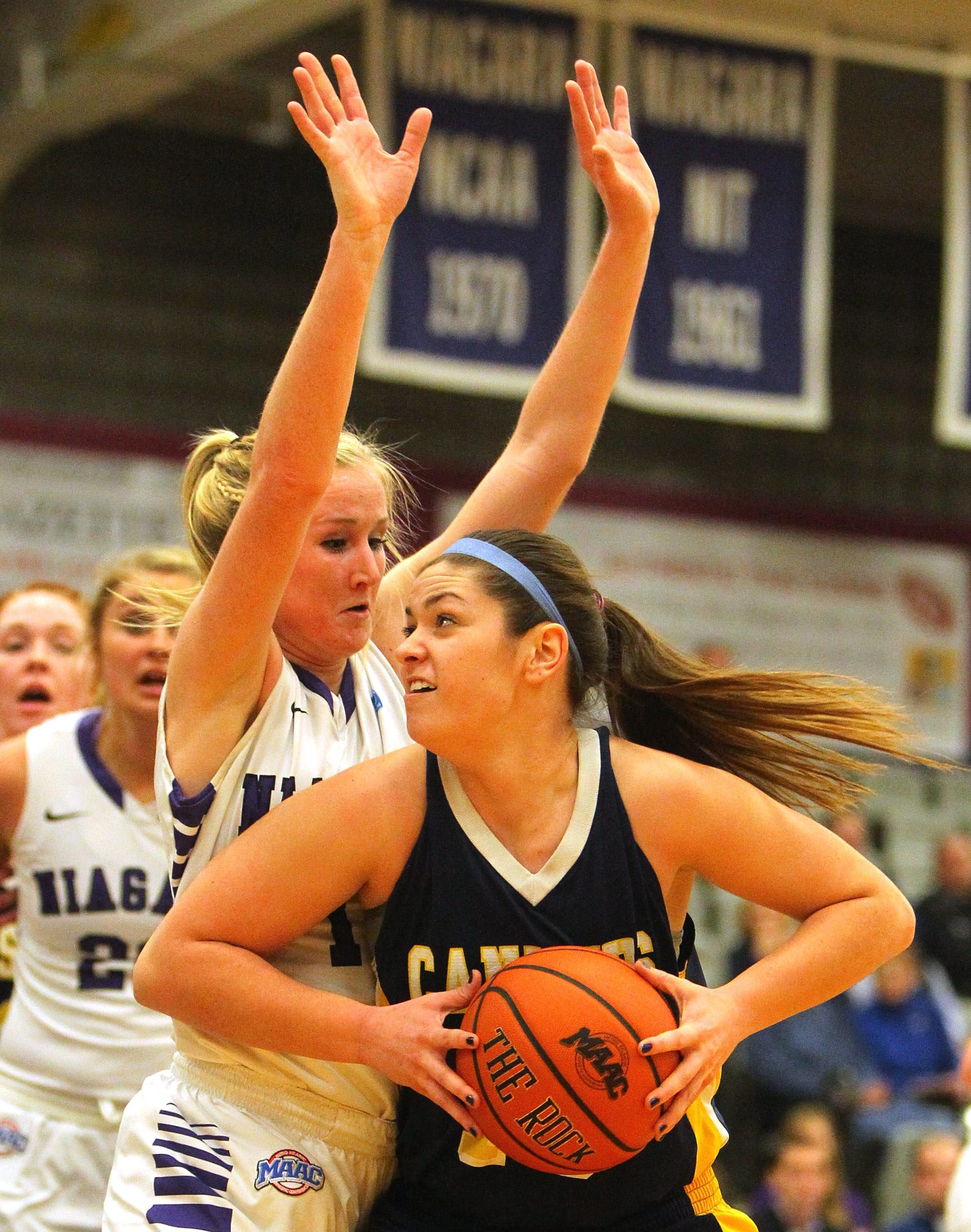 Niagara's Meghan McGuinness had a big night offensively but also shows some defense on Canisius' Lauren D'Hont.