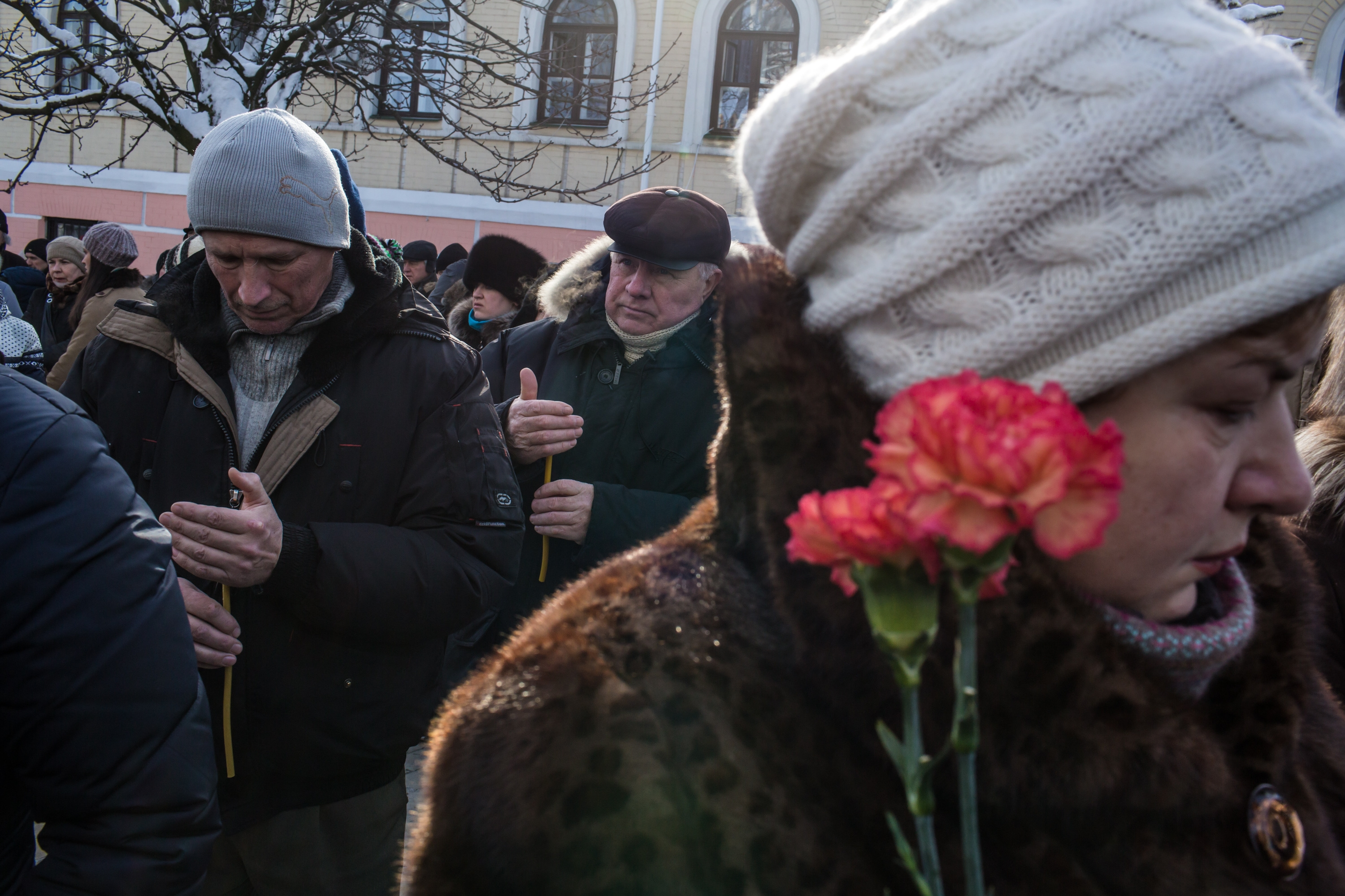 People gather outside Mikhailovsky Cathedral during a service for an anti-government protester who was killed in clashes with police in Kiev, Ukraine, where laws meant to end protests have sparked violent clashes.