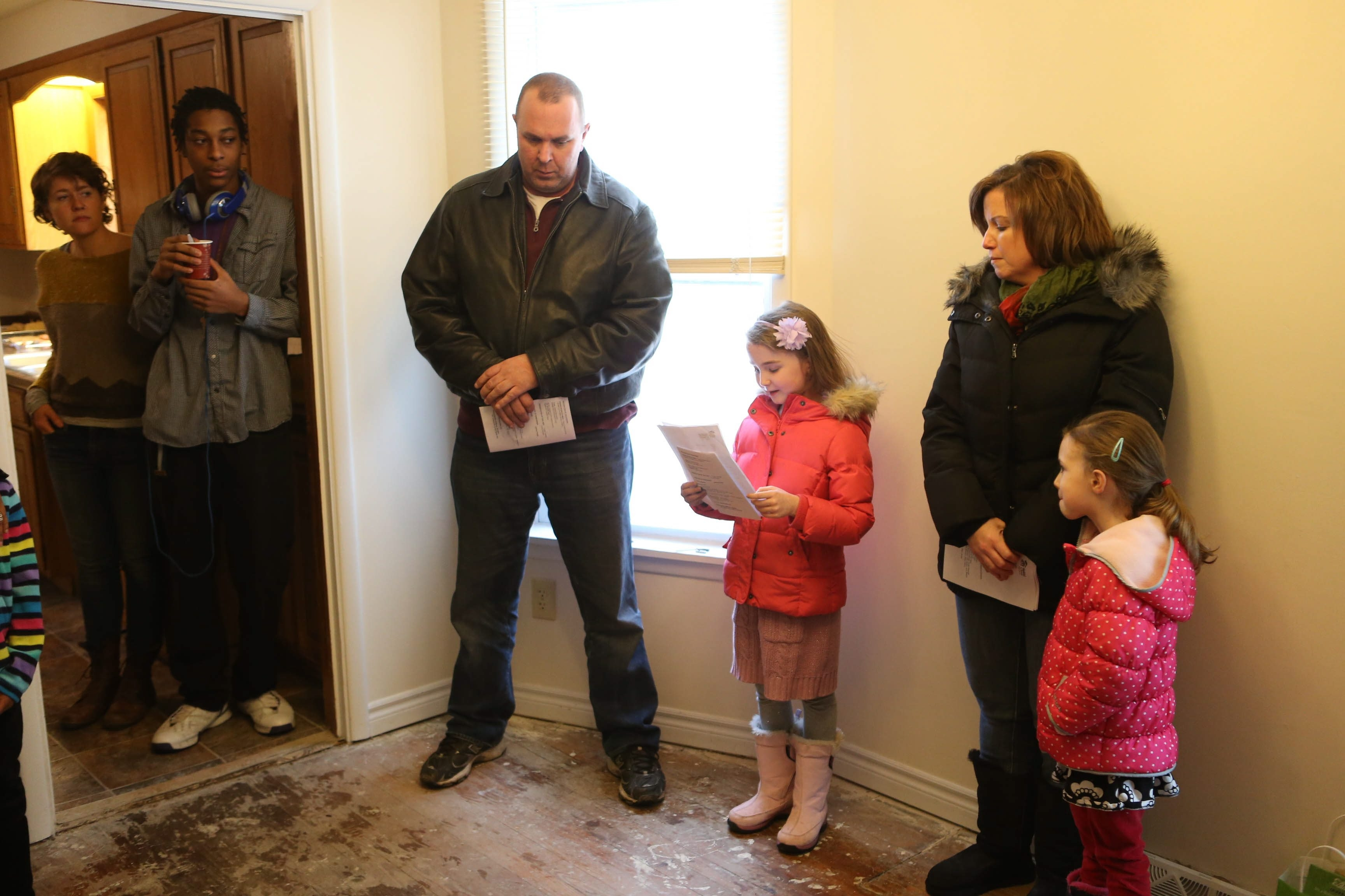 John and Eileen Wargo of Clarence and their daughters Natalie, 7, and Claire, 6, attend the dedication of Habitat for Humanity Buffalo's 250th rehabilitated house Sunday.