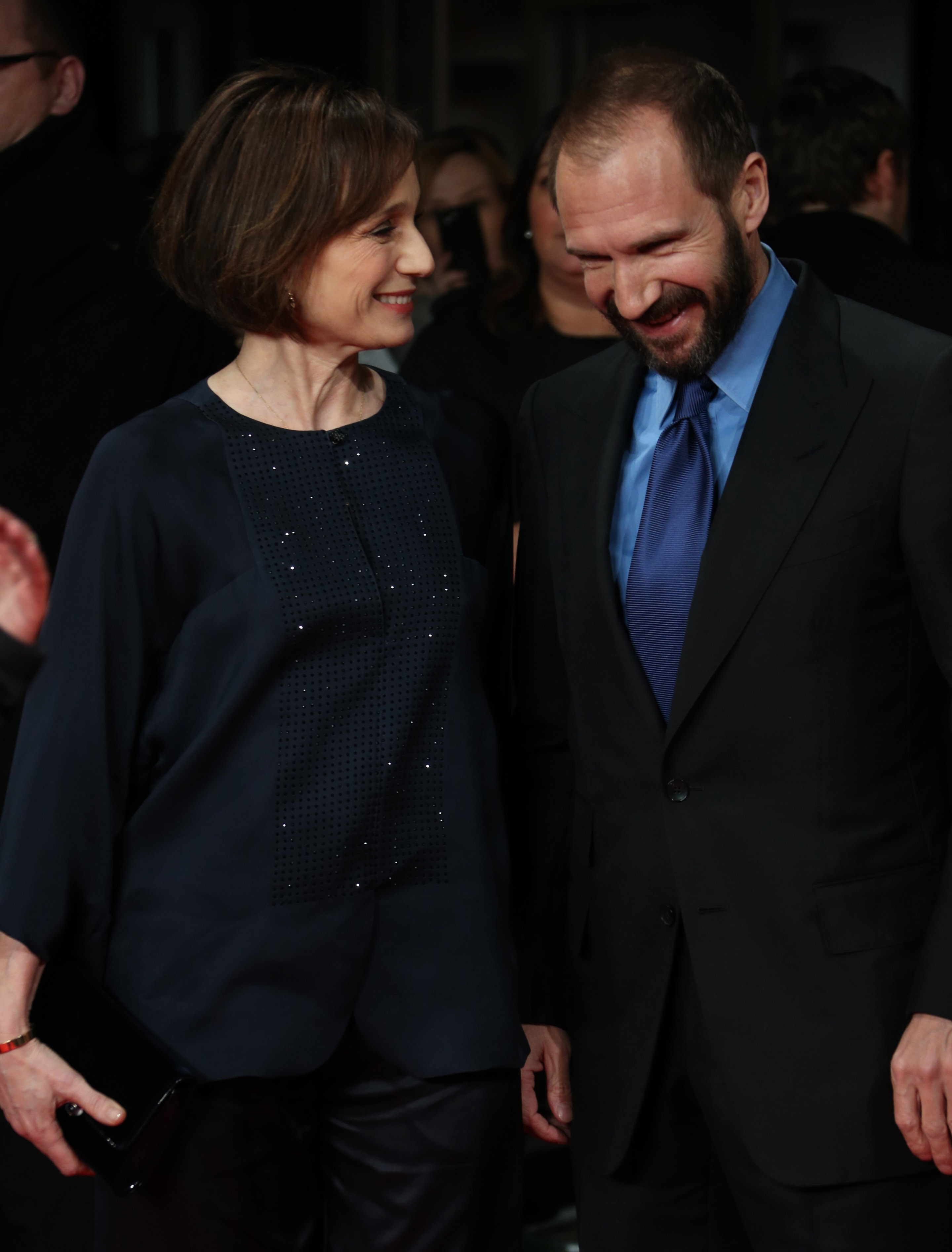 """Visibly happy: Actors Kristin Scott Thomas and Ralph Fiennes arrive on the red carpet Monday for the British premiere of """"The Invisible Woman"""" in London."""