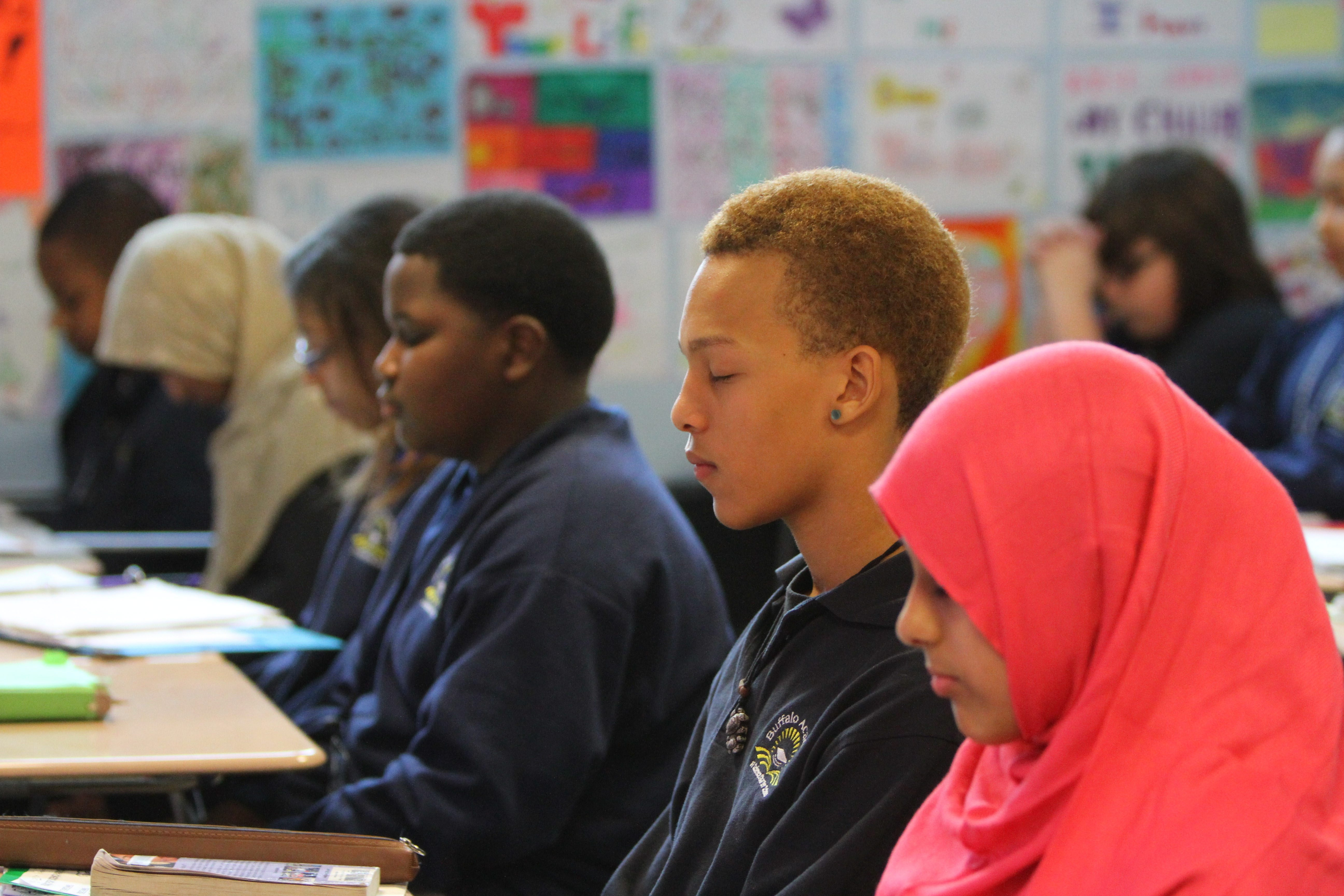 Loren Williamson and his classmates at Buffalo Academy of Science Charter School sit with their eyes closed while breathing deeply and silently reciting an affirmation as part of the MindUP Program, which teaches meditation techniques to boost confidence and optimism.