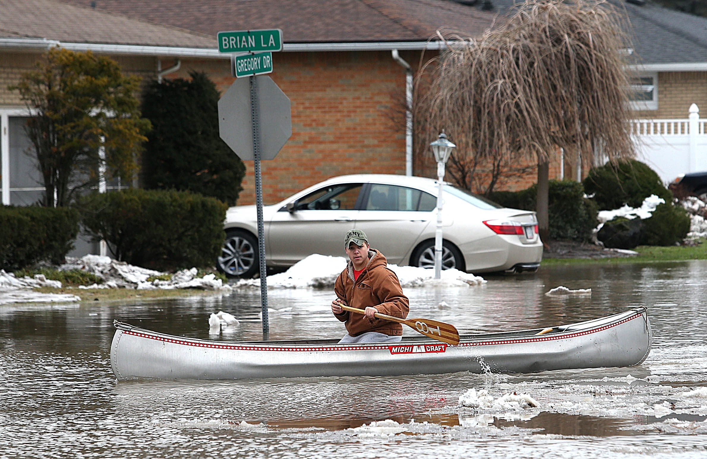 Ben Lang, of Elma, had to use a canoe to check on his grandmother after flooding devastated her neighborhood in West Seneca. (Robert Kirkham/Buffalo News)