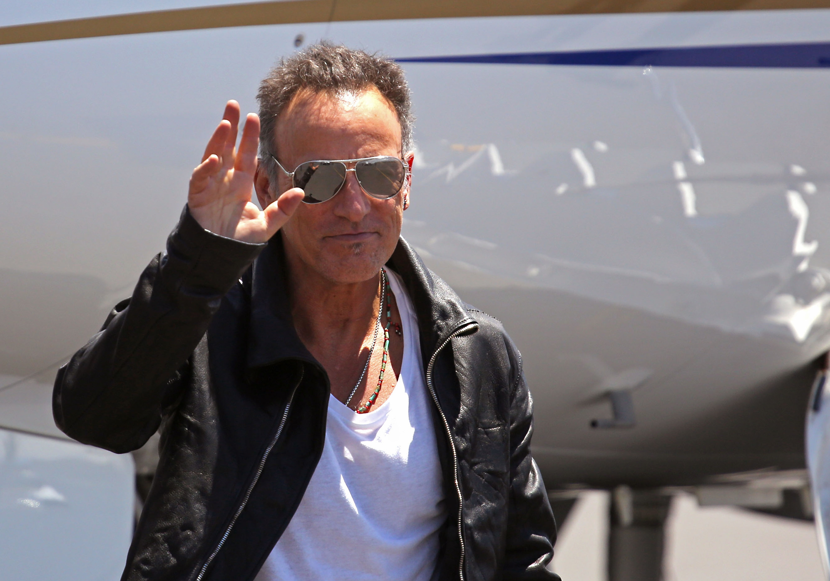 Bruce Springsteen waves as he arrives in Cape Town, South Africa, on Friday. His E Street Band plans four concerts in Cape Town and Johannesburg.