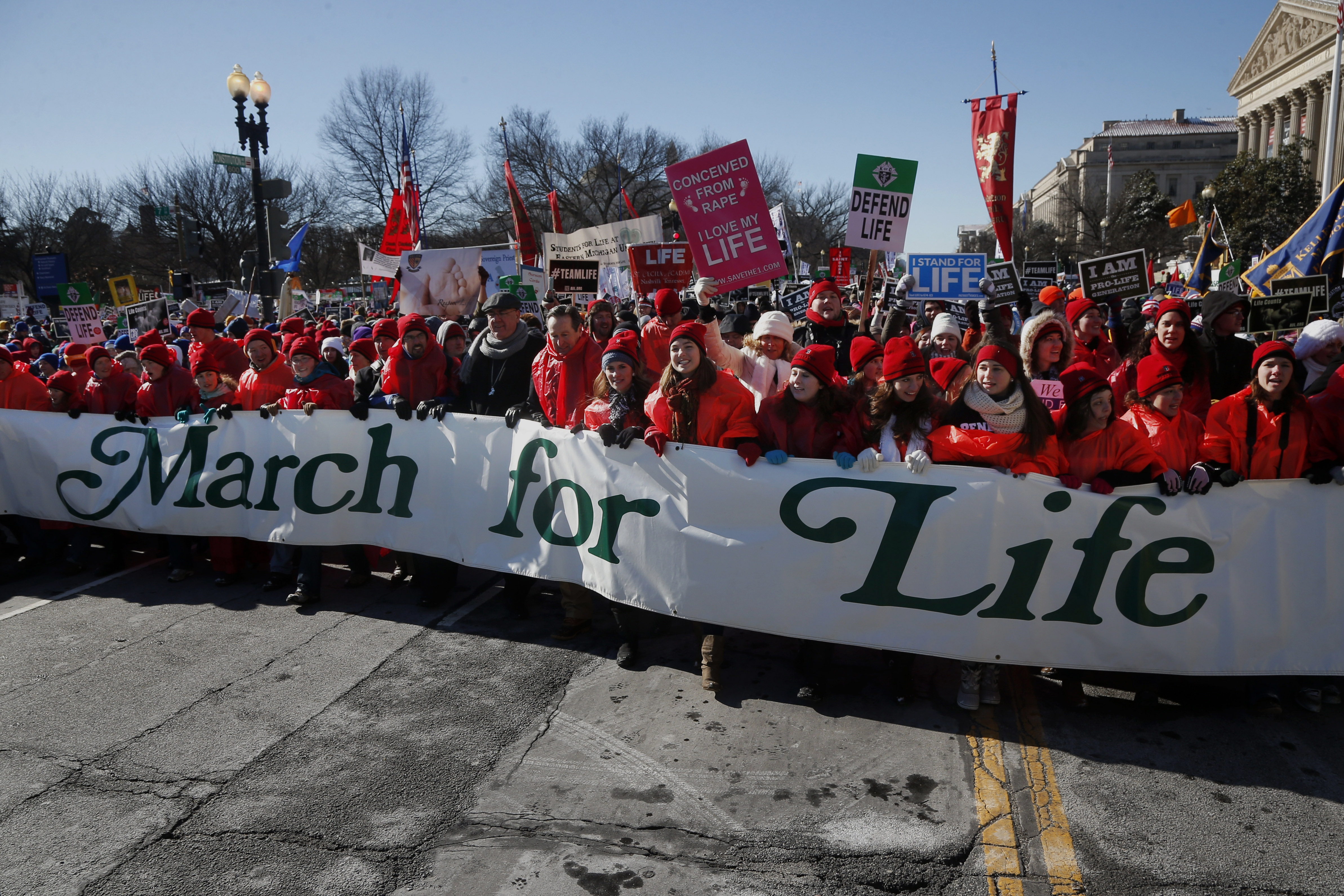 Anti-abortion demonstrators march up Constitution Avenue toward the Supreme Court in Washington today.