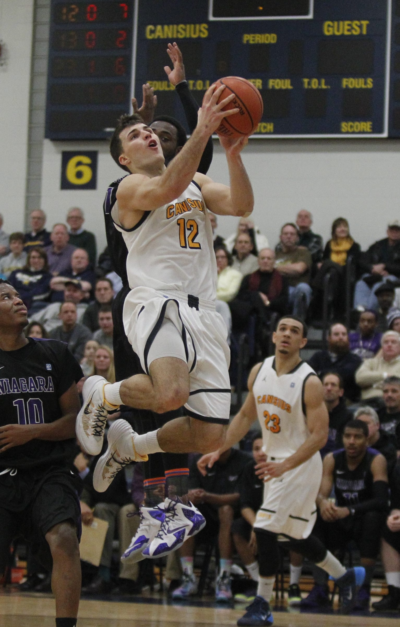 Billy Baron of Canisius goes up strong. Baron scored 31 points and withstood a bloody collision.