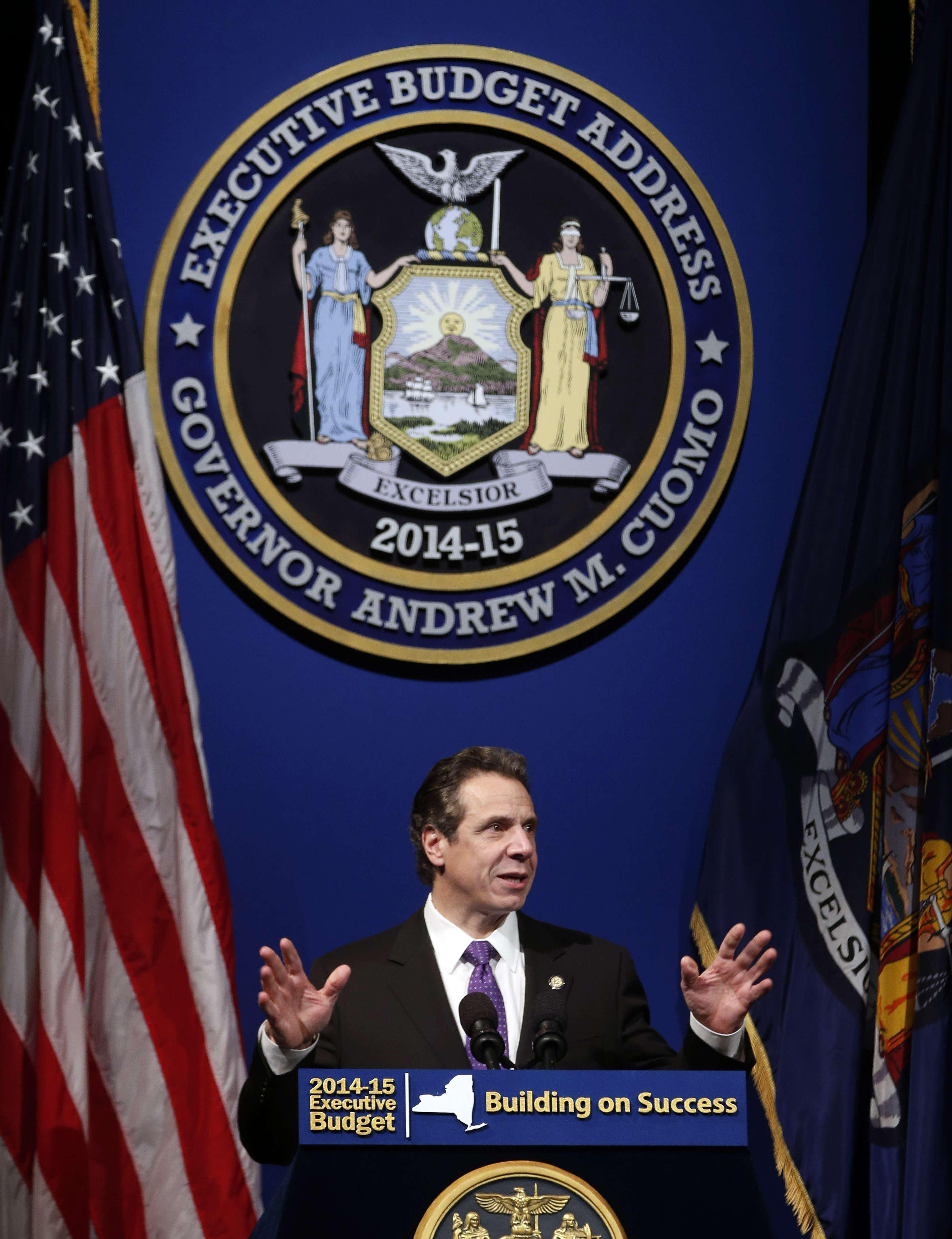 New York Gov. Andrew Cuomo presents his 2014-15 executive budget proposal at the Hart Theatre on Tuesday, Jan. 21, 2014, in Albany, N.Y. (AP Photo/Mike Groll)