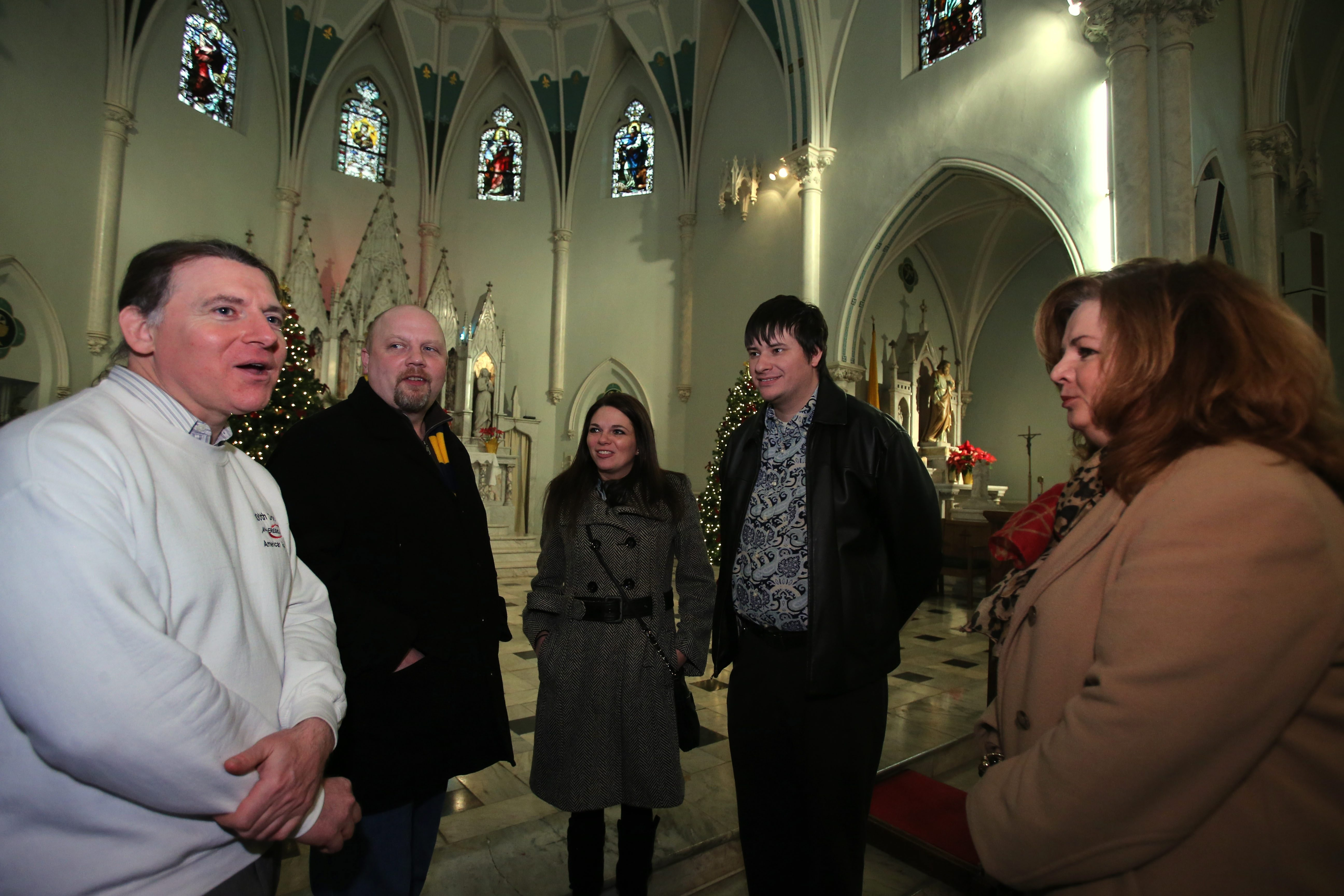 'Mass Mob' organizers, left to right, Alan Oberst, Chris Byrd, Danielle Huber and Greg Witul talk with Darlene Gerevics-Koch, at Our Lady of Perpetual Help Church.