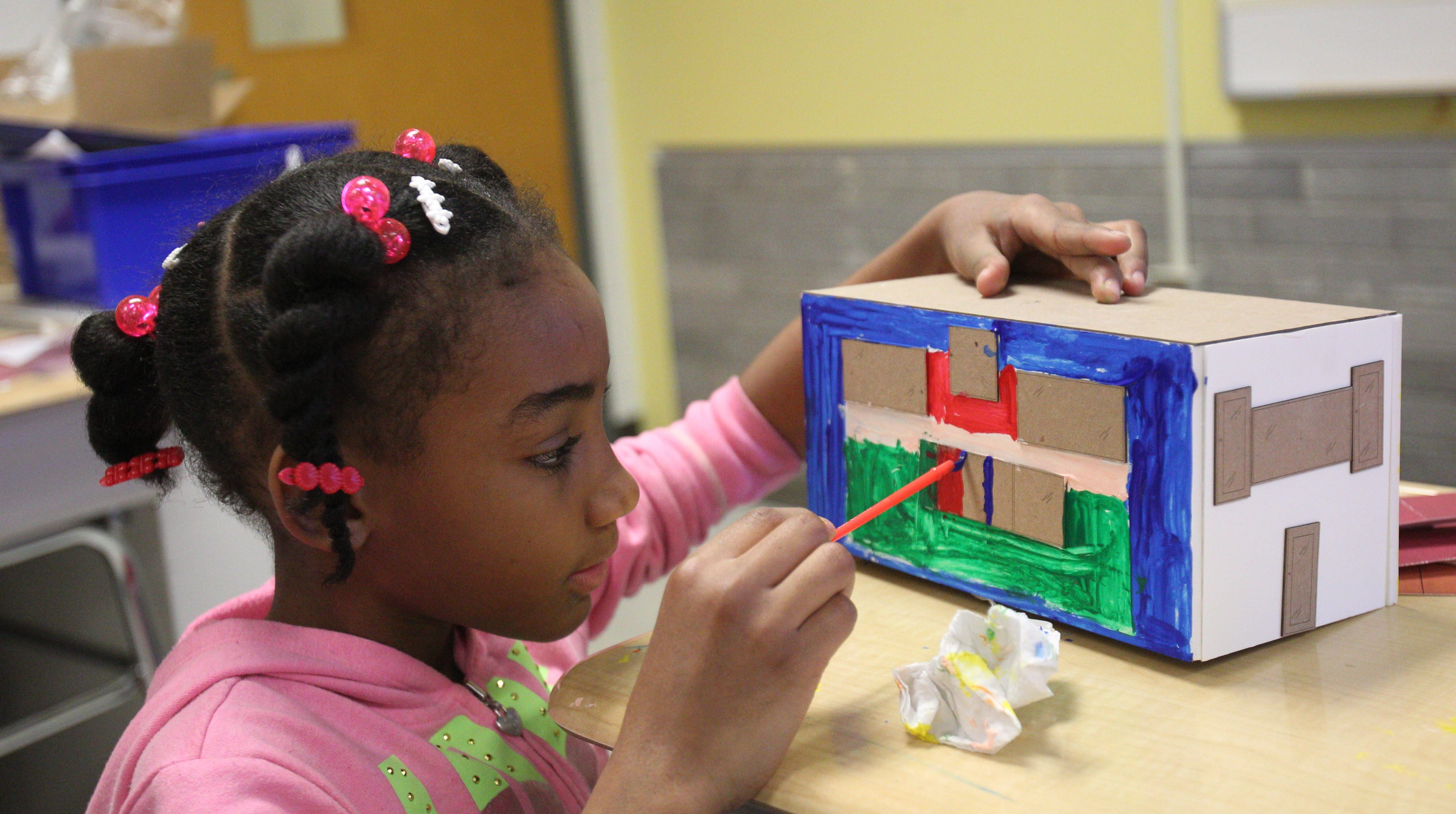 Shenelle Brown works at School 53 on the house she designed as part of the Architecture + Education program.