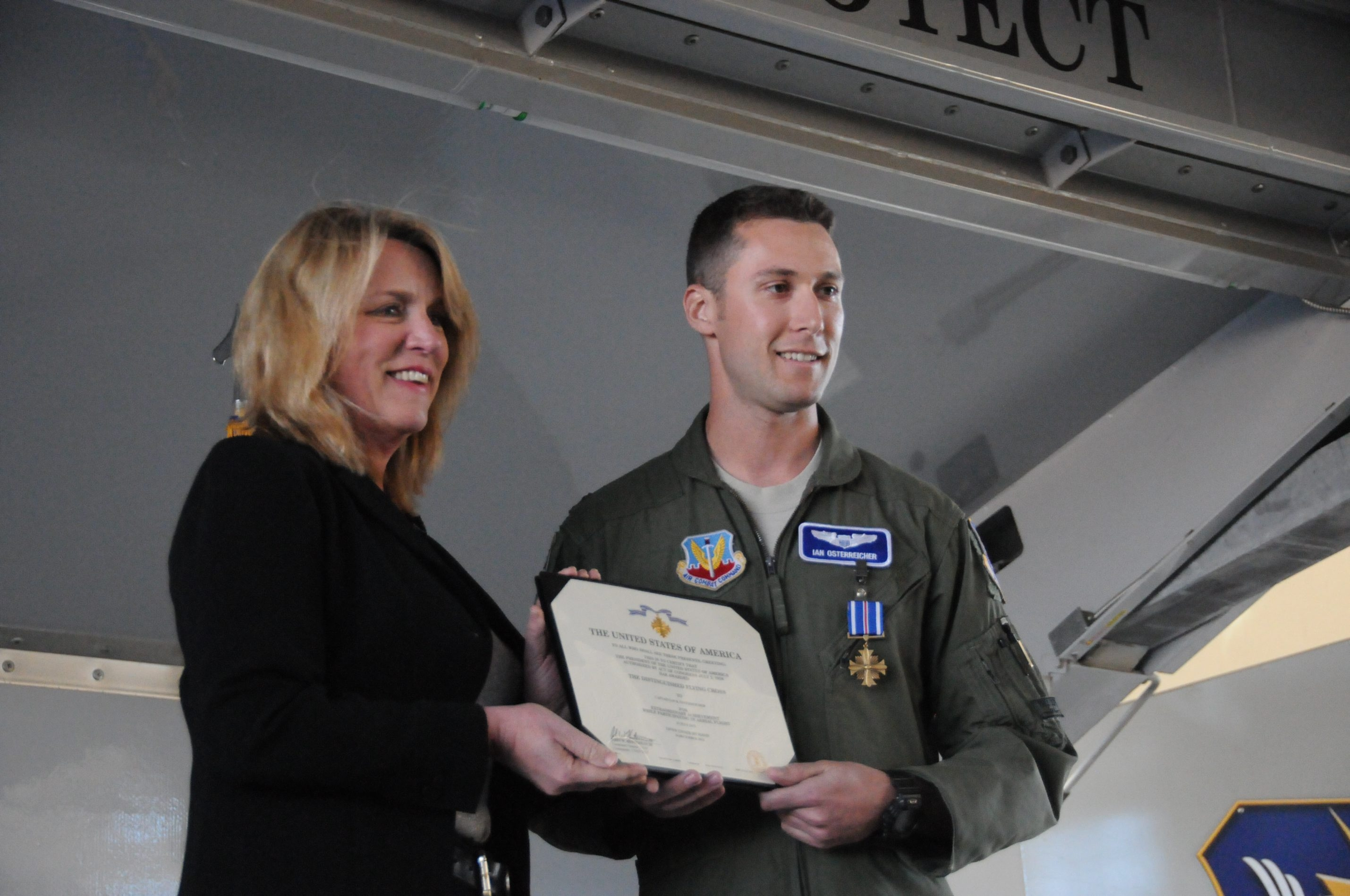U.S. Air Force Secretary Deborah Lee James presents the Distinguished Flying Cross to former Amherst resident Capt. Ian R. Osterreicher for his action in Afghanistan at Moody Air Force Base in Valdosta, Ga., on Friday.