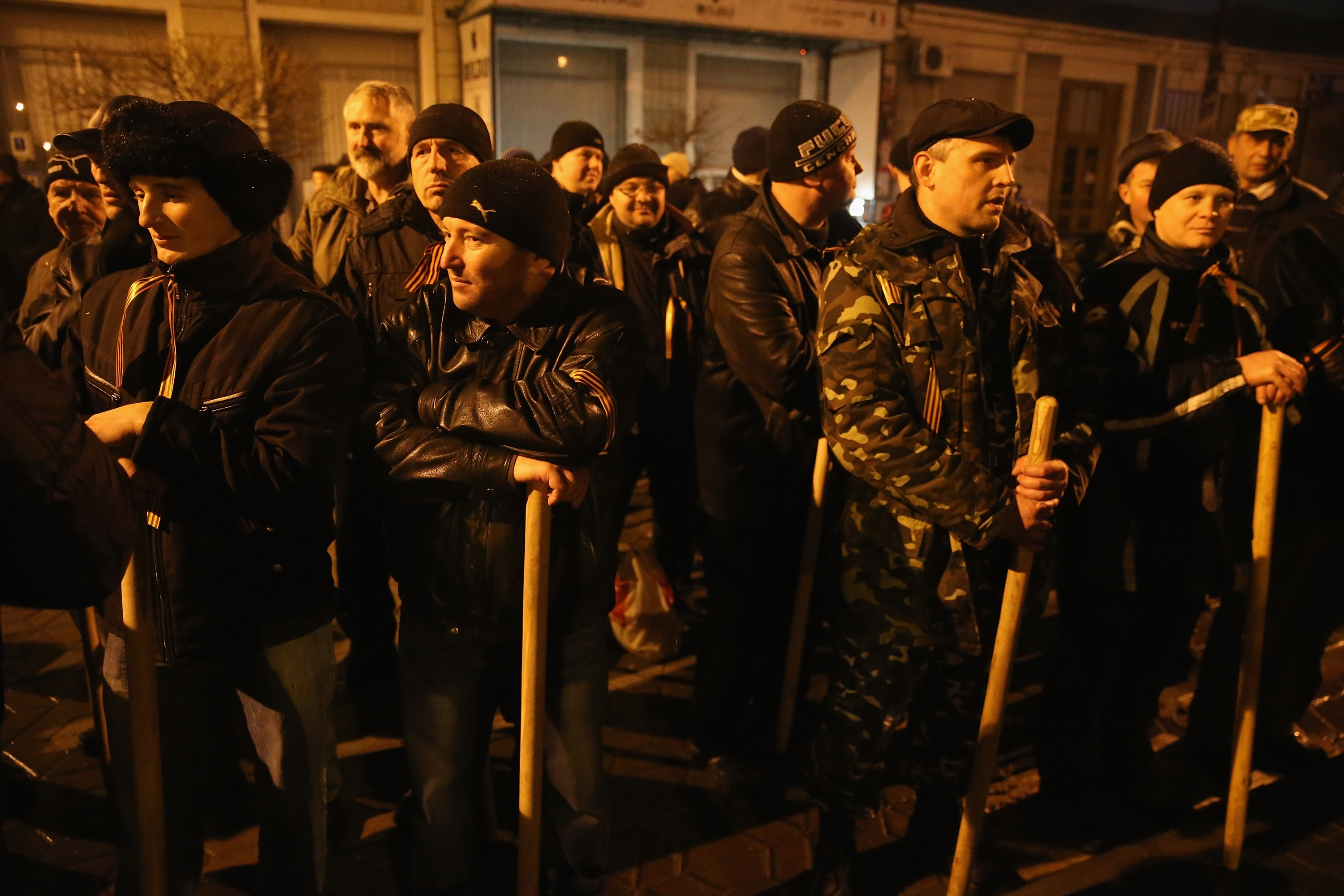 Pro-Russian men armed with clubs gather outside the Crimea regional parliament building in Simferopol, Ukraine, after parliamentarians voted for a May 25th referendum on Crimea's autonomy earlier Thursday.