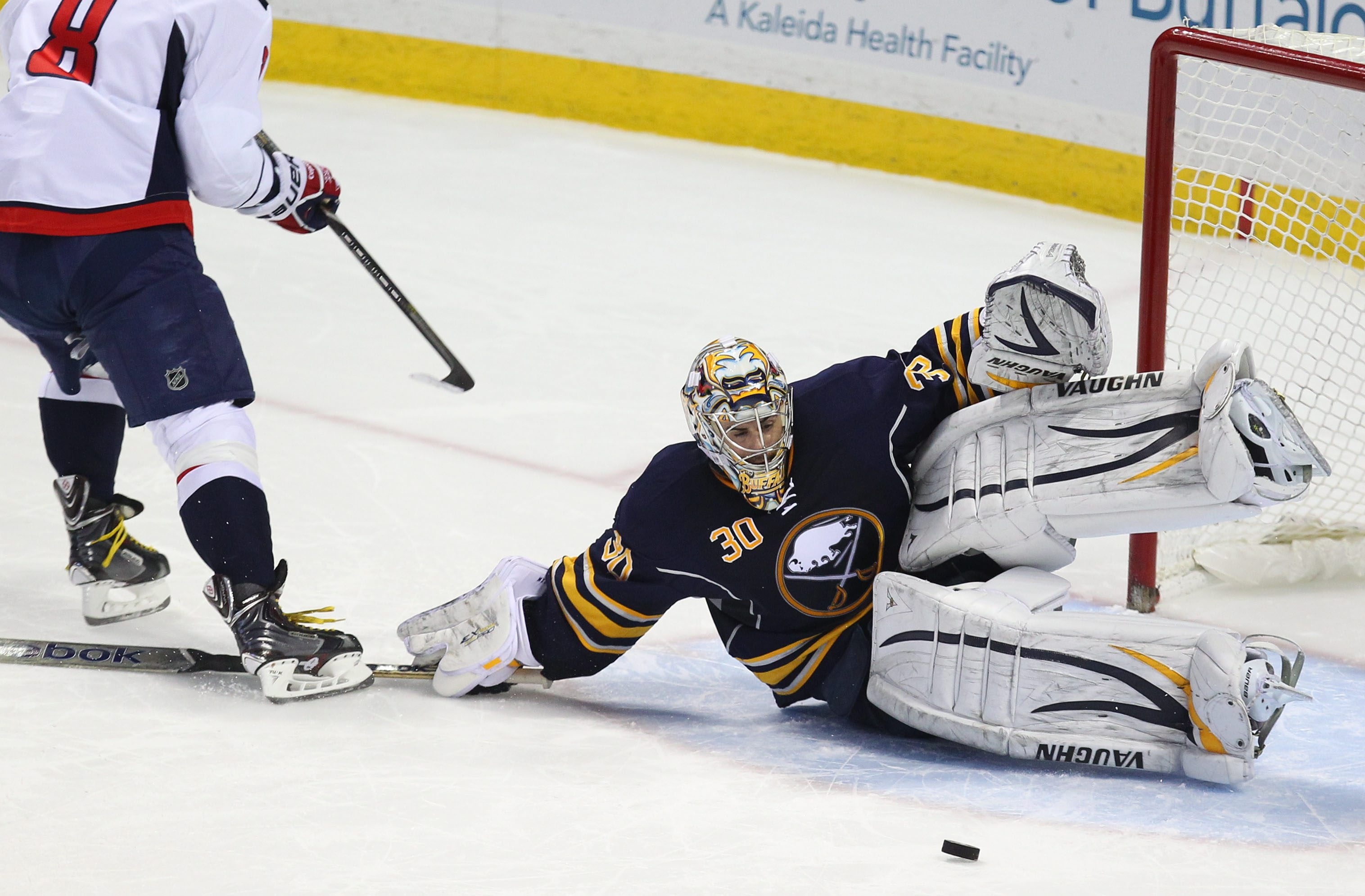 Ryan Miller stops the Capital's Alex Ovechkin in the shootout period at the First Niagara Center in Buffalo Sunday, December 29, 2013. He set a career high with 49 saves, plus another six in shootout in 2-1 victory.  (Mark Mulville/Buffalo News)