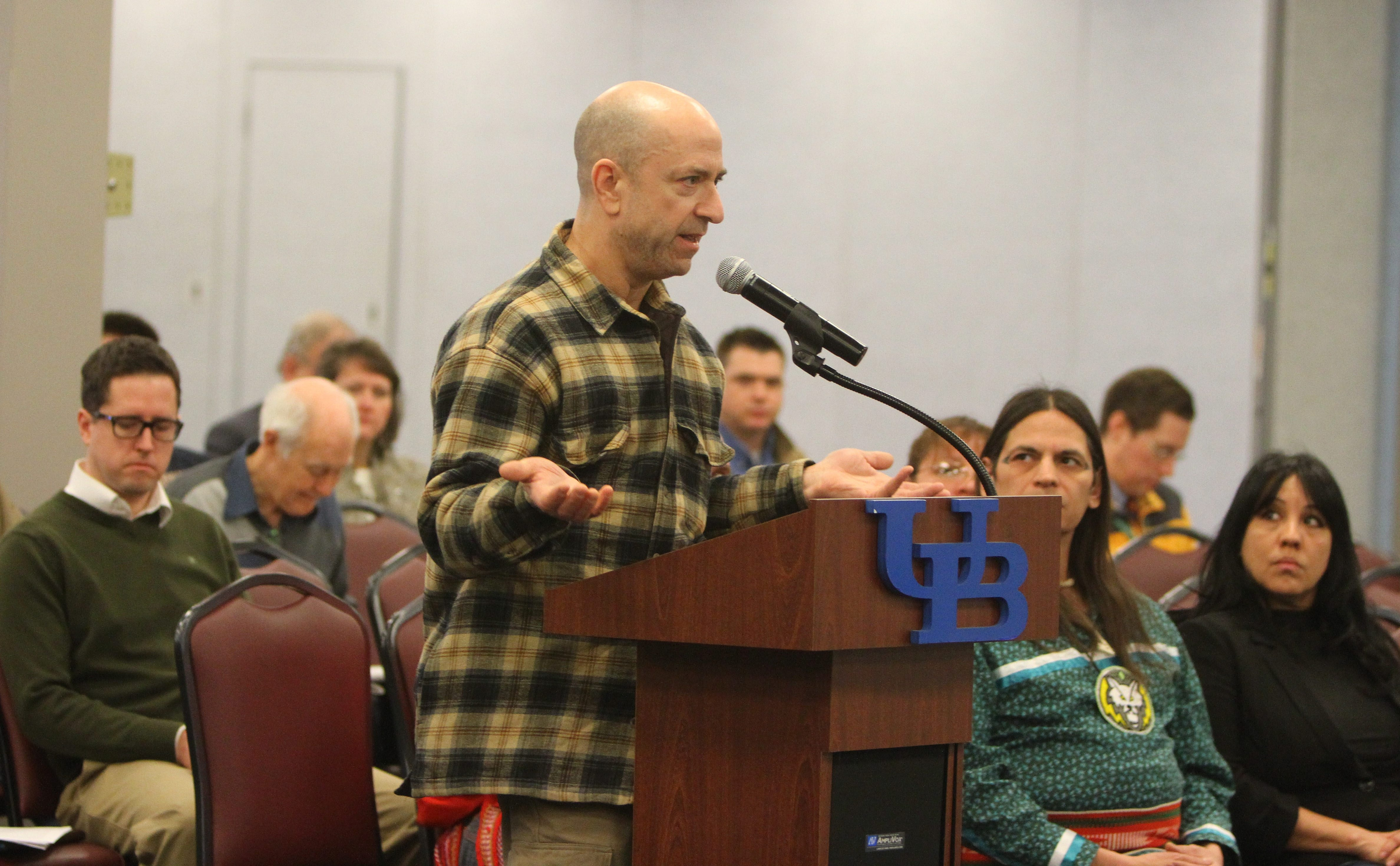 James C. Hufnagel, of Wilson, addresses panel during hearing at UB on the state's draft energy plan, calling on the governor to make his position clear on whether hydrofracking should be part of it.