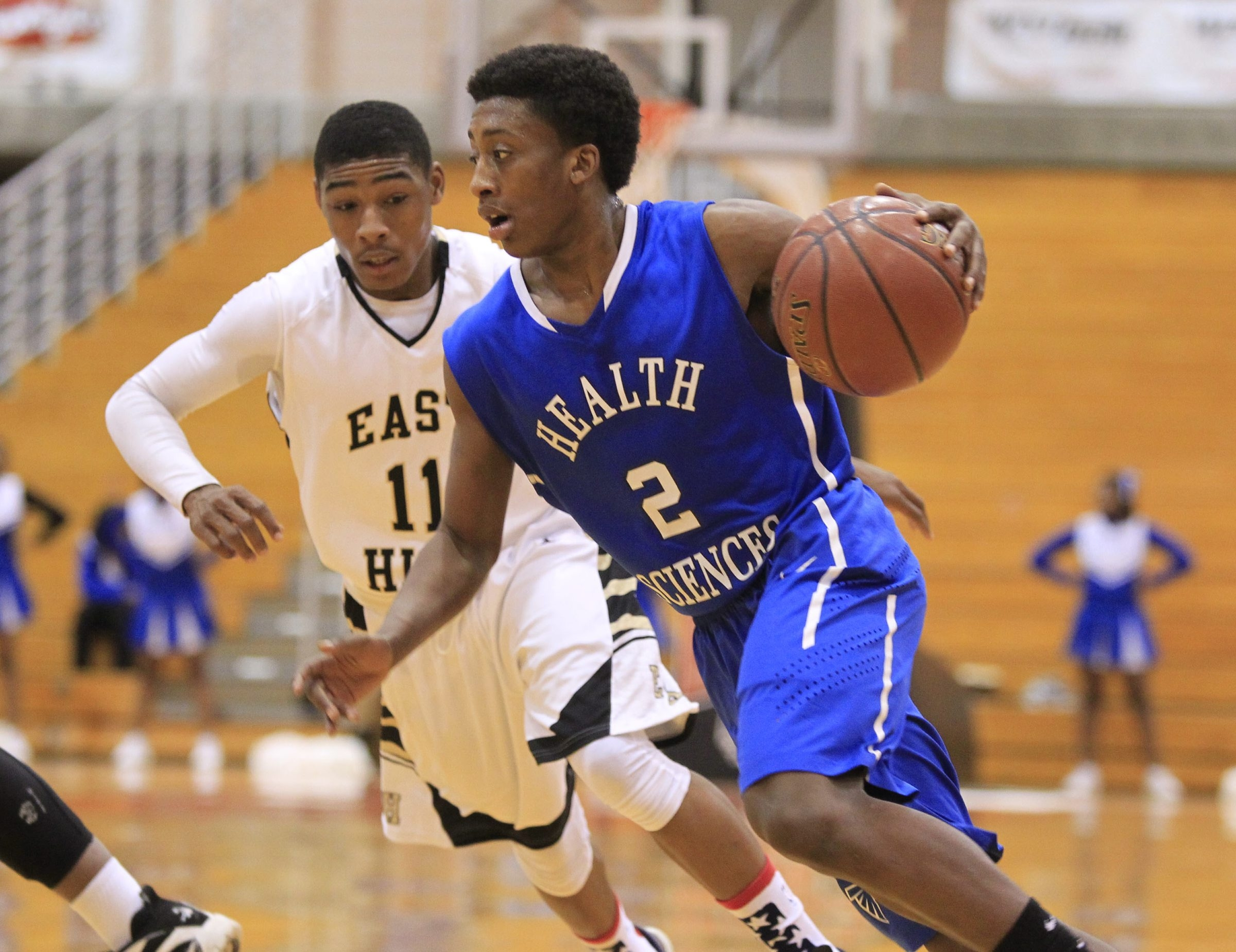 East's Percy Bryant is in pursuit of Health Sciences' Allen Wright during the Class B-2 semifinal at the Buffalo State Sports Arena.