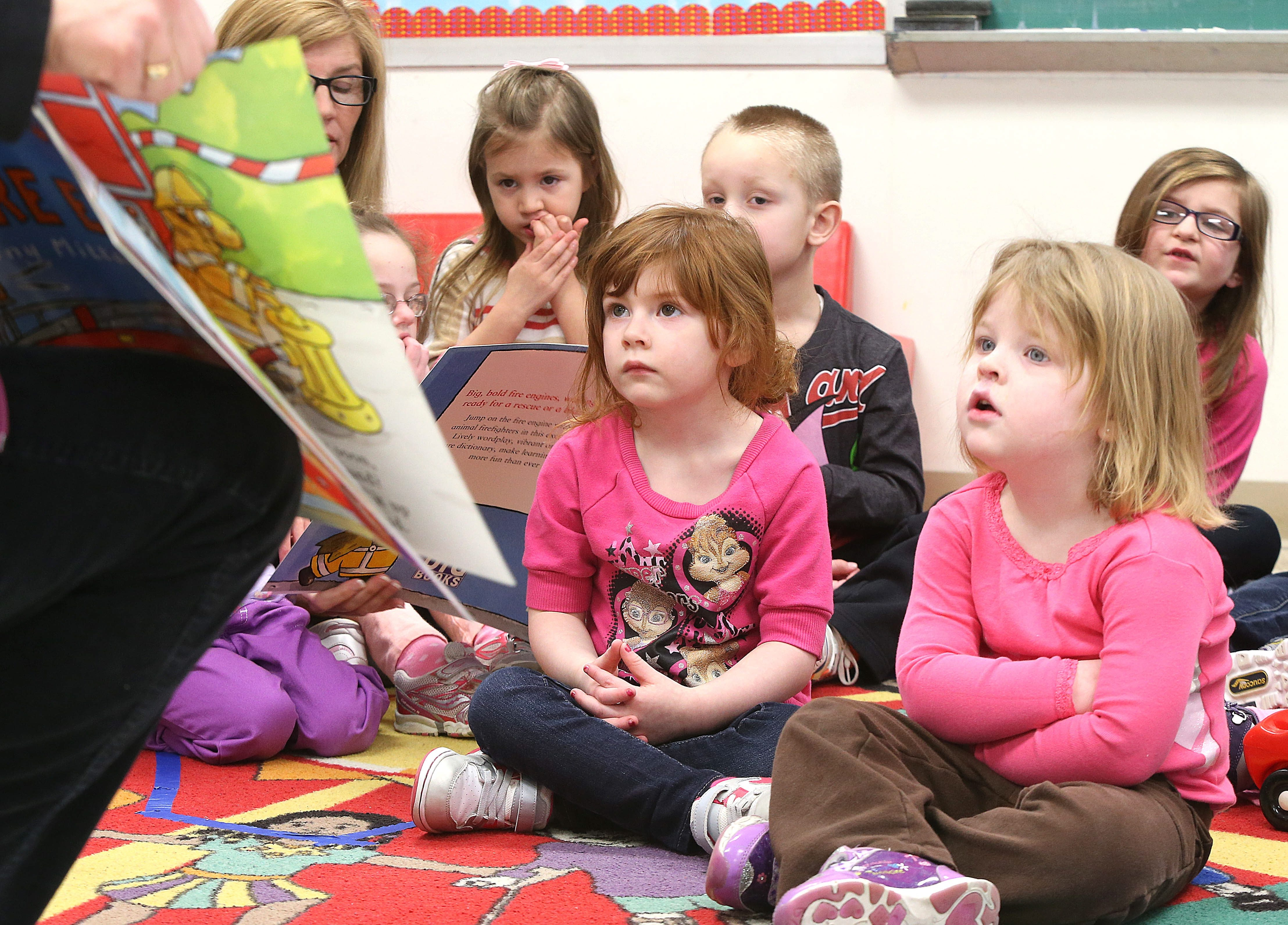 Prekindergarten students at Olmsted Center for Sight listen as a book is read Tuesday at the announcement of the Books for Kids kickoff.