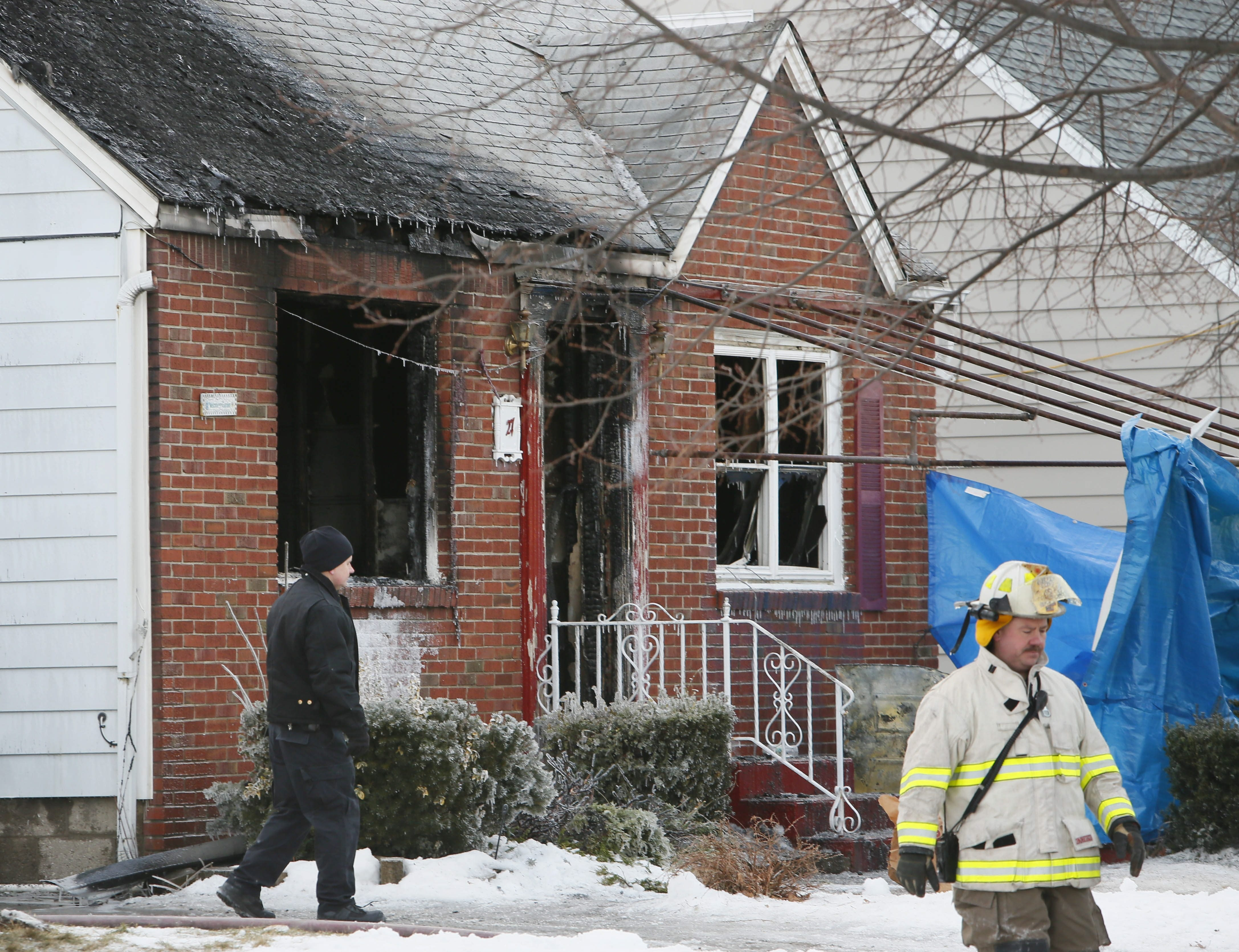 Police and firefighters investigate at the scene of a fatal house fire Tuesday on Furlong Road in Cheektowaga.