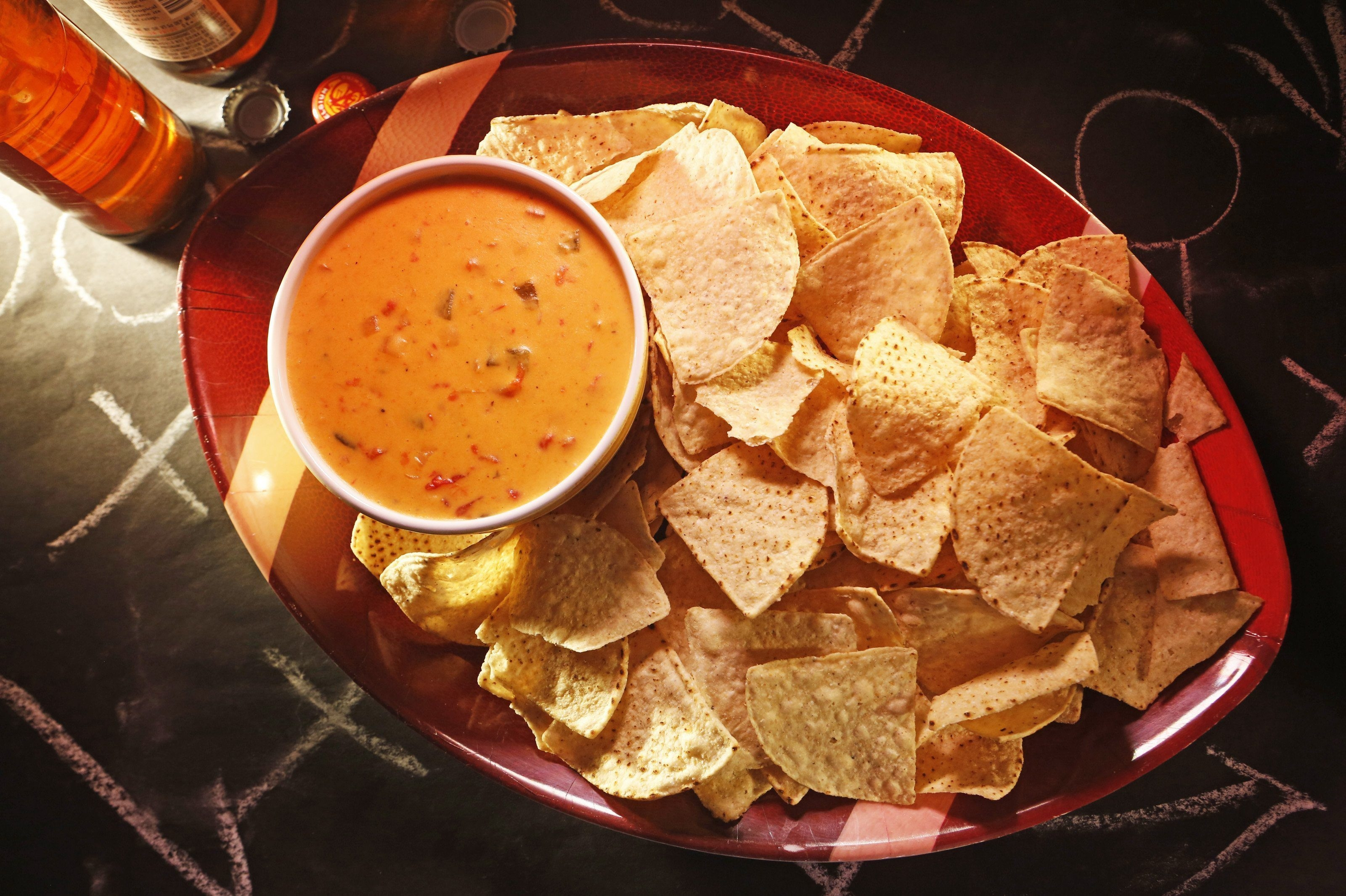 Processed cheese melts better than real cheese, making it the perfect cheese for a queso dip.