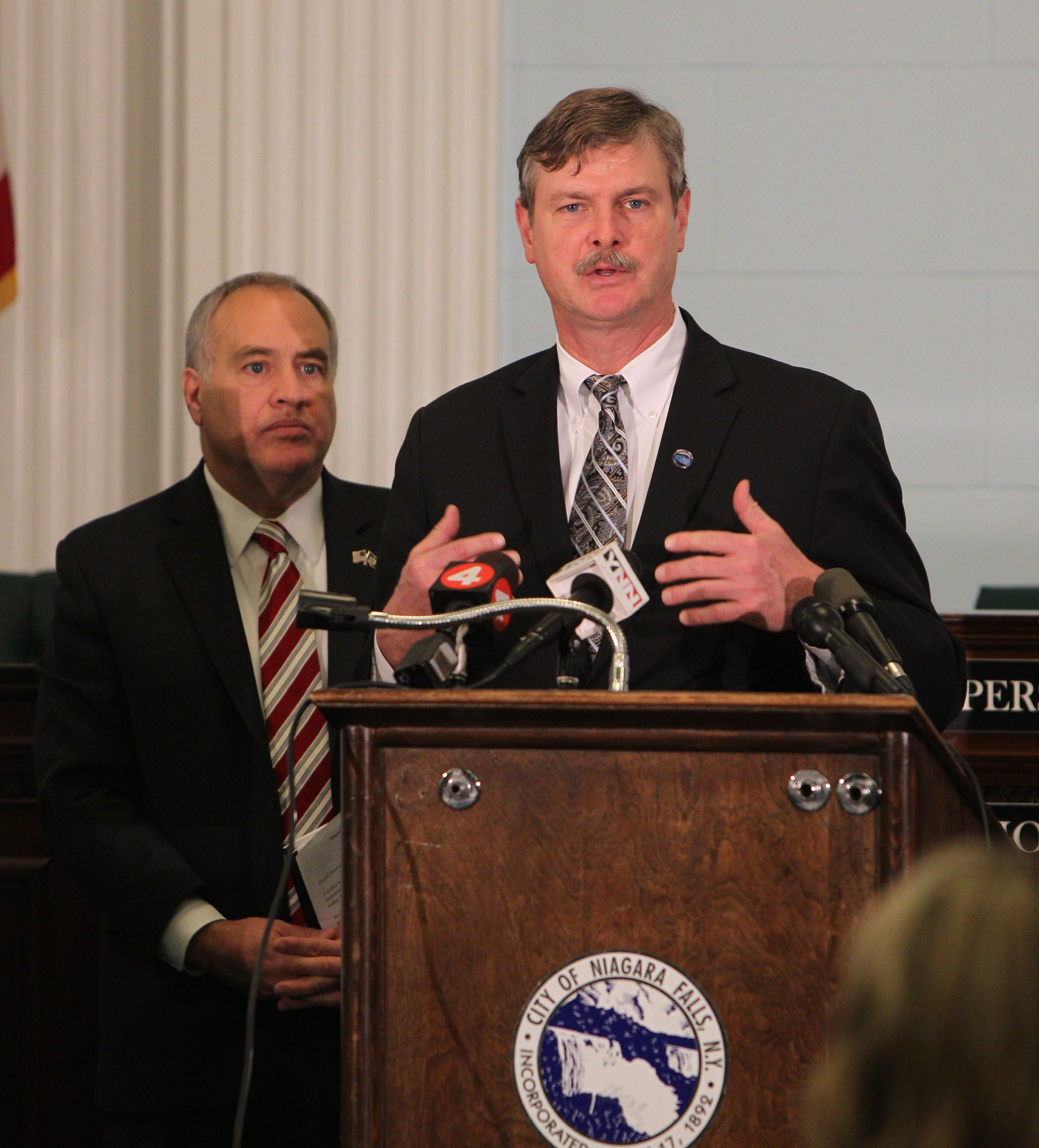 Niagara Falls Mayor Paul A. Dyster speaks at news conference in December 2012 as State Comptroller Thomas Di Napoli looks on.