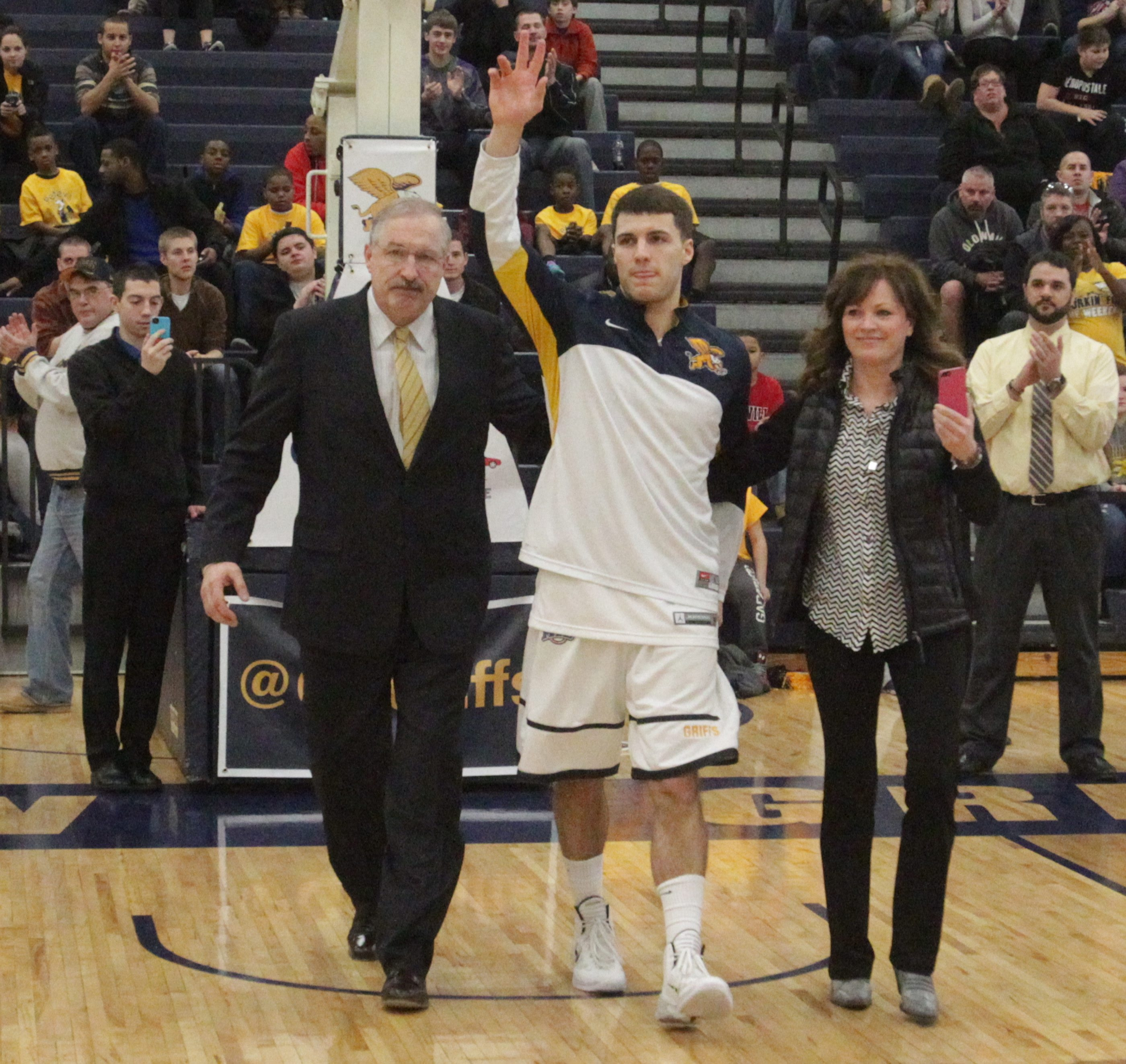 Canisius guard Billy Baron walks out to the cheers of the crowd with his mother, Cindy, and dad, Jim Baron, on Saturday.