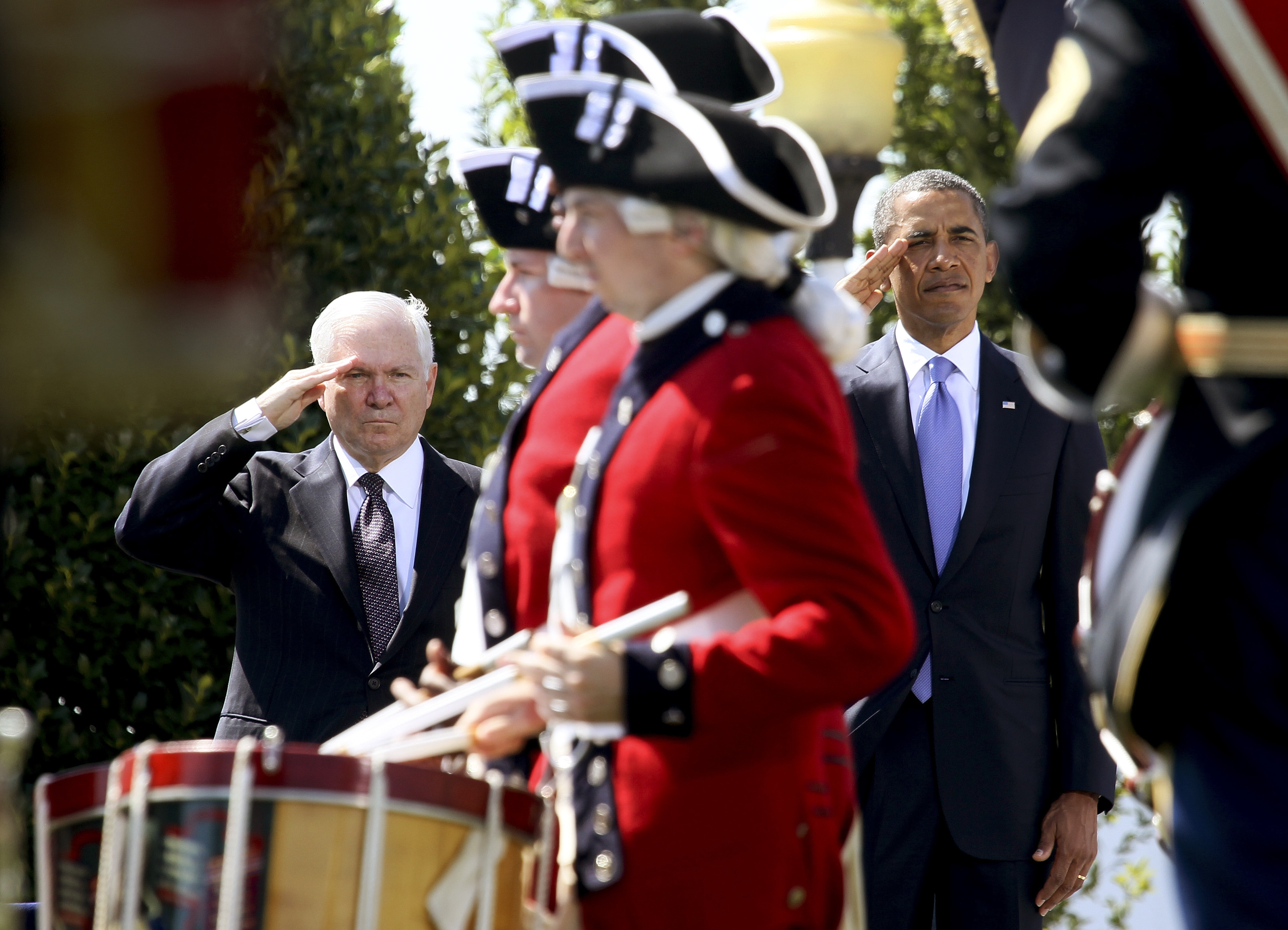 FILE -- President Barack Obama and Secretary of Defense Robert Gates salute during the Armed Forces Farewell Tribute in honor of Gates at the Pentagon in Washington, June 30, 2011.  þÄúDuty: Memoirs of a Secretary at War,þÄù Gates' new memoir, offers 600 pages of detailed history of his personal wars with Congress, the Pentagon bureaucracy and, in particular, ObamaþÄôs White House staff. (Doug Mills/The New York Times)