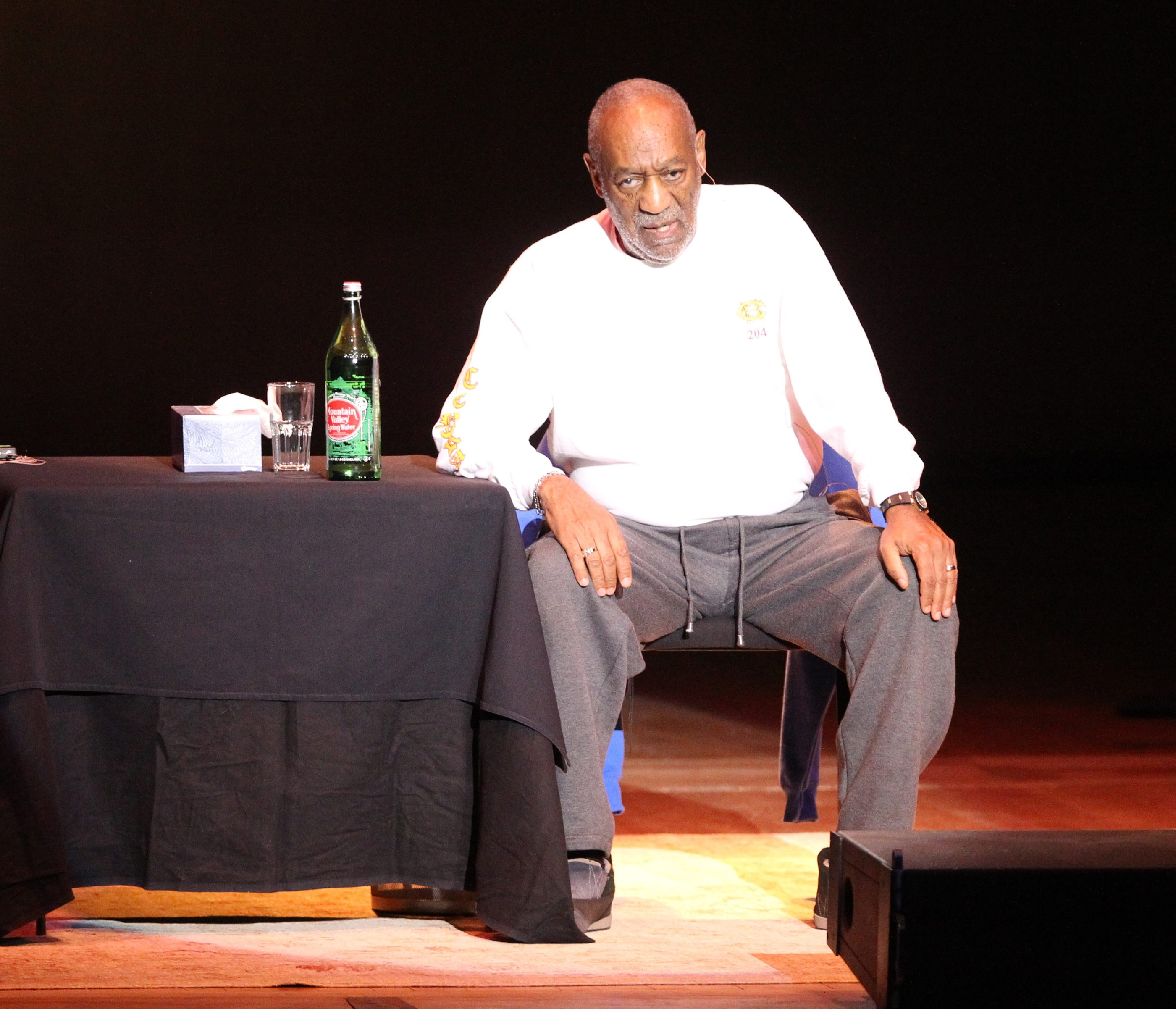 Bill Cosby sits in a chair center stage and tells funny stories while performing at  Kleinhans Music Hall in Buffalo,NY on March 15, 2013.  (James P. McCoy/Buffalo News)