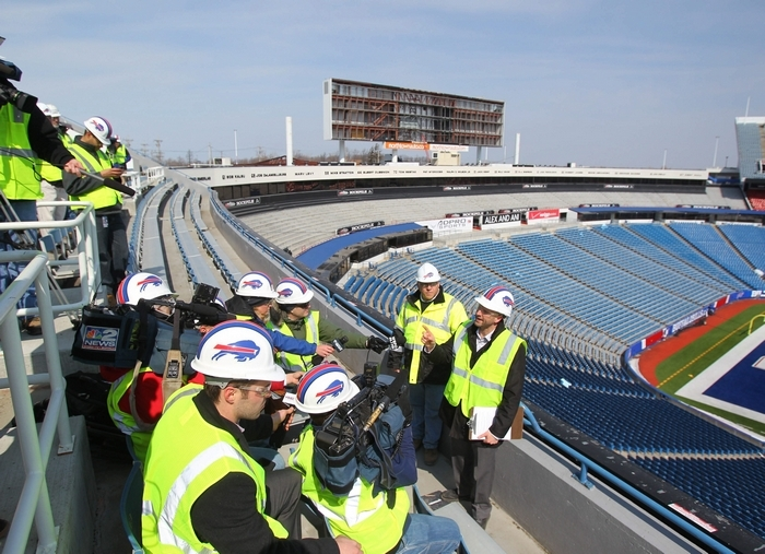 Marc Honan, the Bills' vice president for marketing and broadcasting, makes a point Tuesday as he and Joe Frandina, to his right, director of construction management, conduct a tour for reporters showing progress of the $130 million in renovations at Ralph Wilson Stadium. (Mark Mulville/Buffalo News)