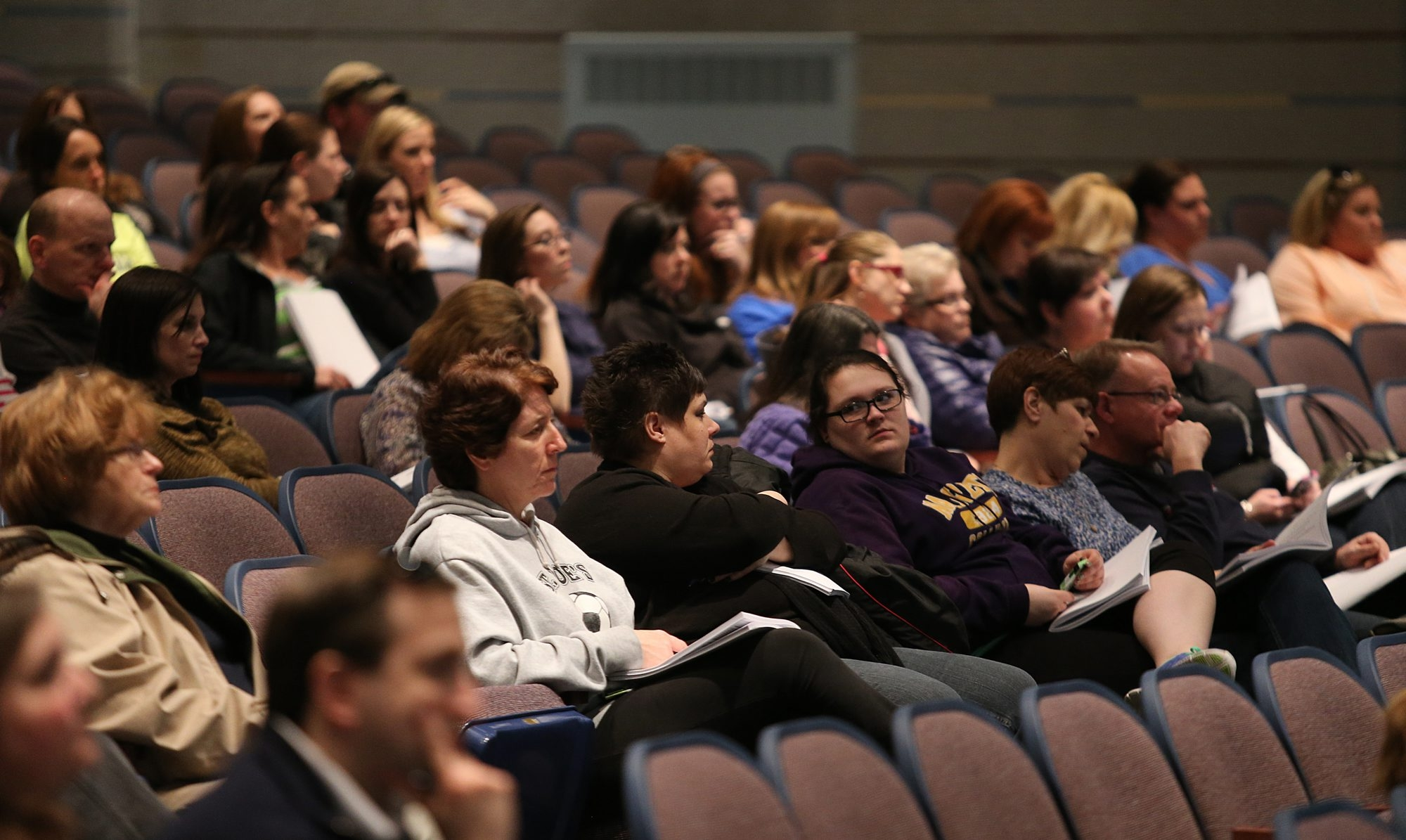 Audience members listen to Ken-Ton Superintendent Mark P. Mondanaro during a public hearing in the auditorium of Kenmore East High School.