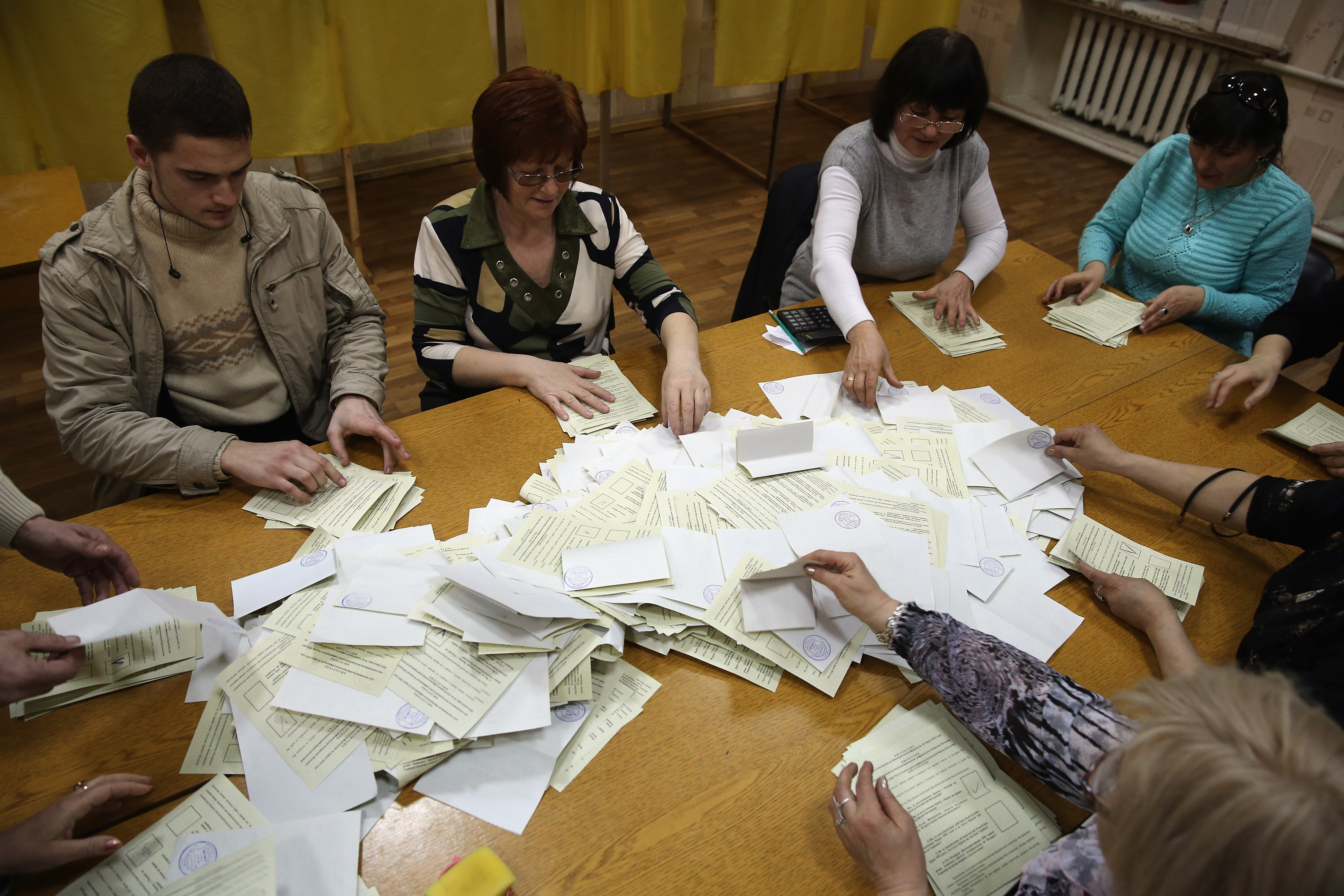 Election staff begin to count votes at a polling station in Bachchisaray, Ukraine, on March 16. Reports from Crimea cast into doubt the results of that day's vote.